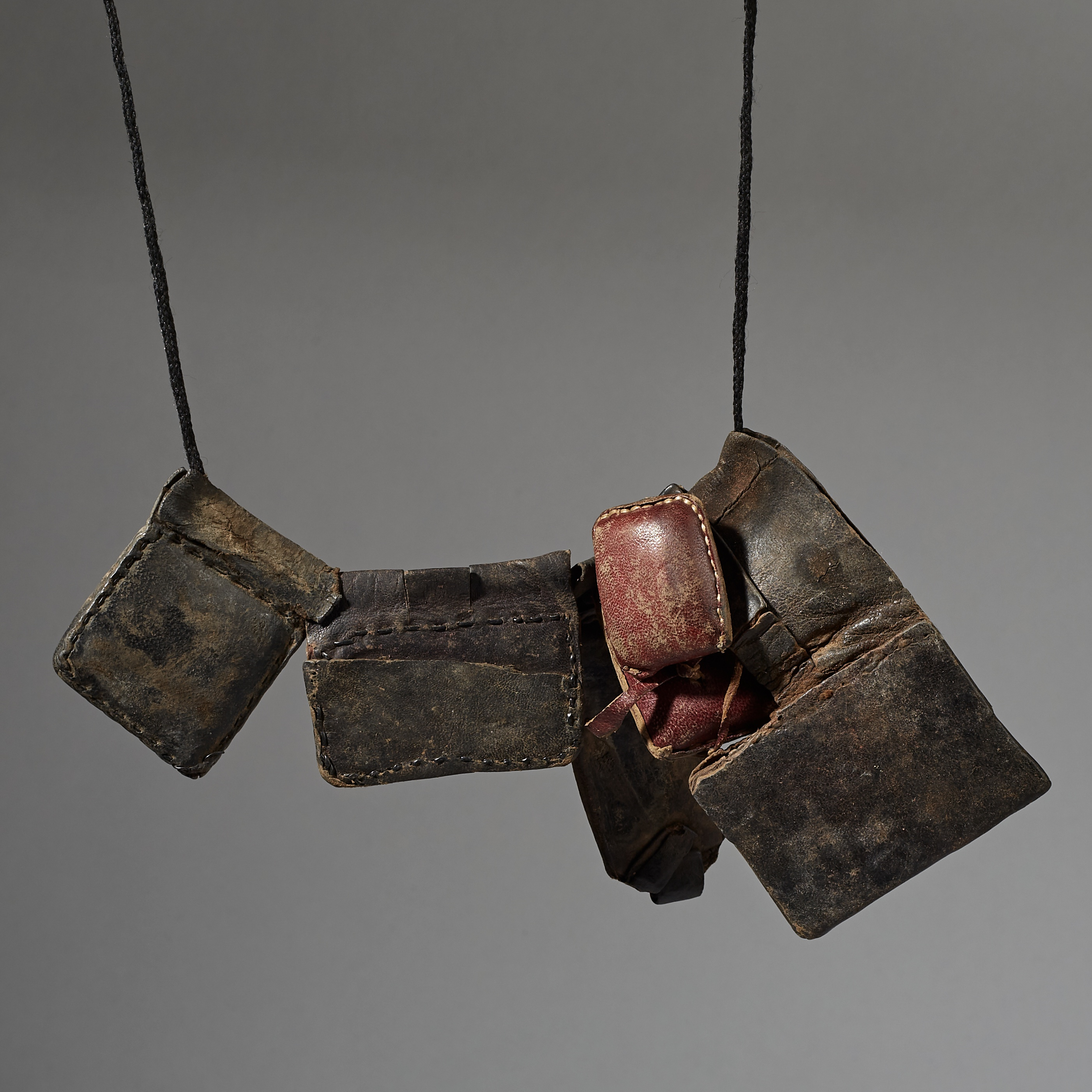 A LEATHER TALISMANIC NECKLACE FROM THE TUAREG TRIBE OF THE SAHARA ( No 3041 )