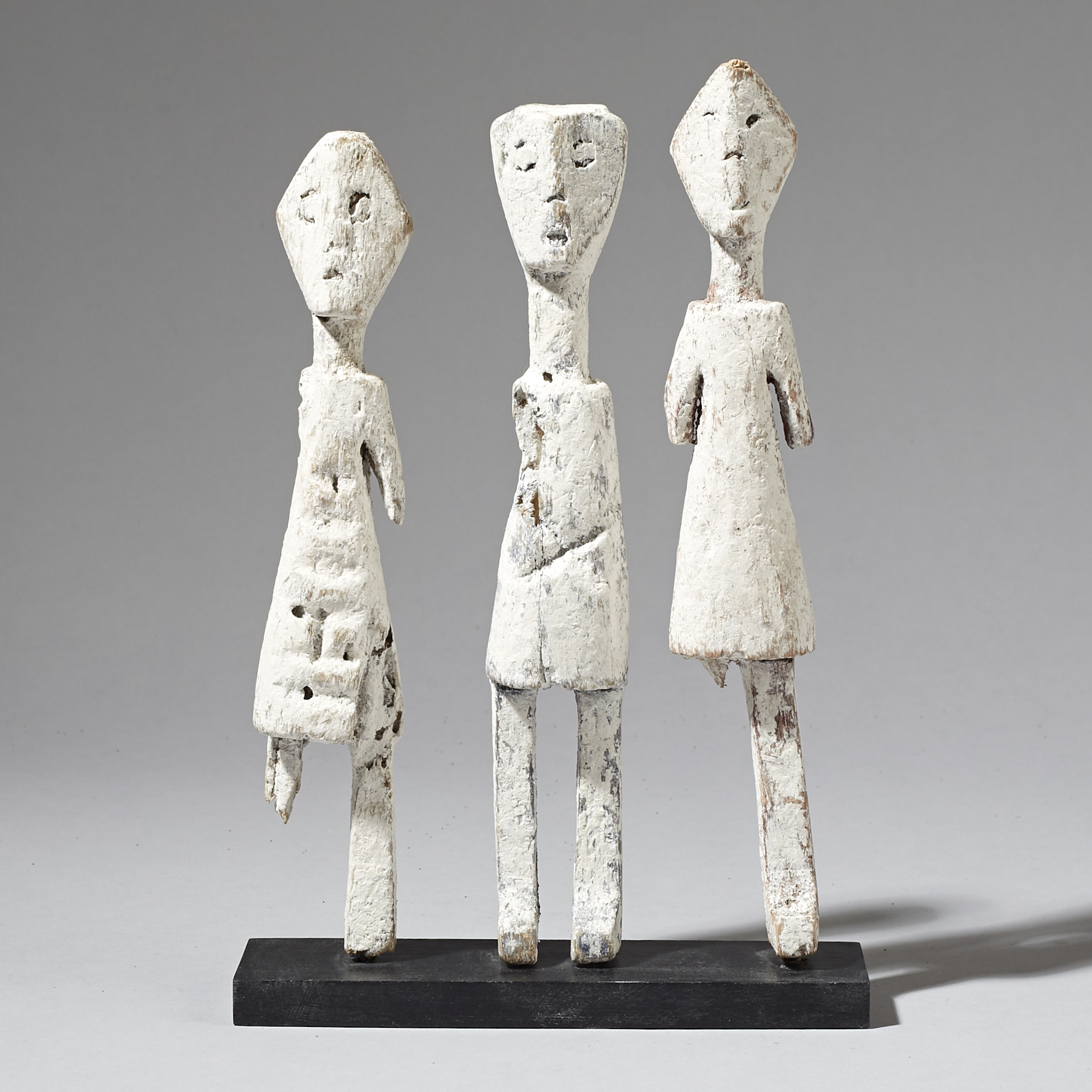 A KAOLIN ENCRUSTED FAMILY OF ADAN ANCESTOR FIGURES, GHANA ( No 2963 )