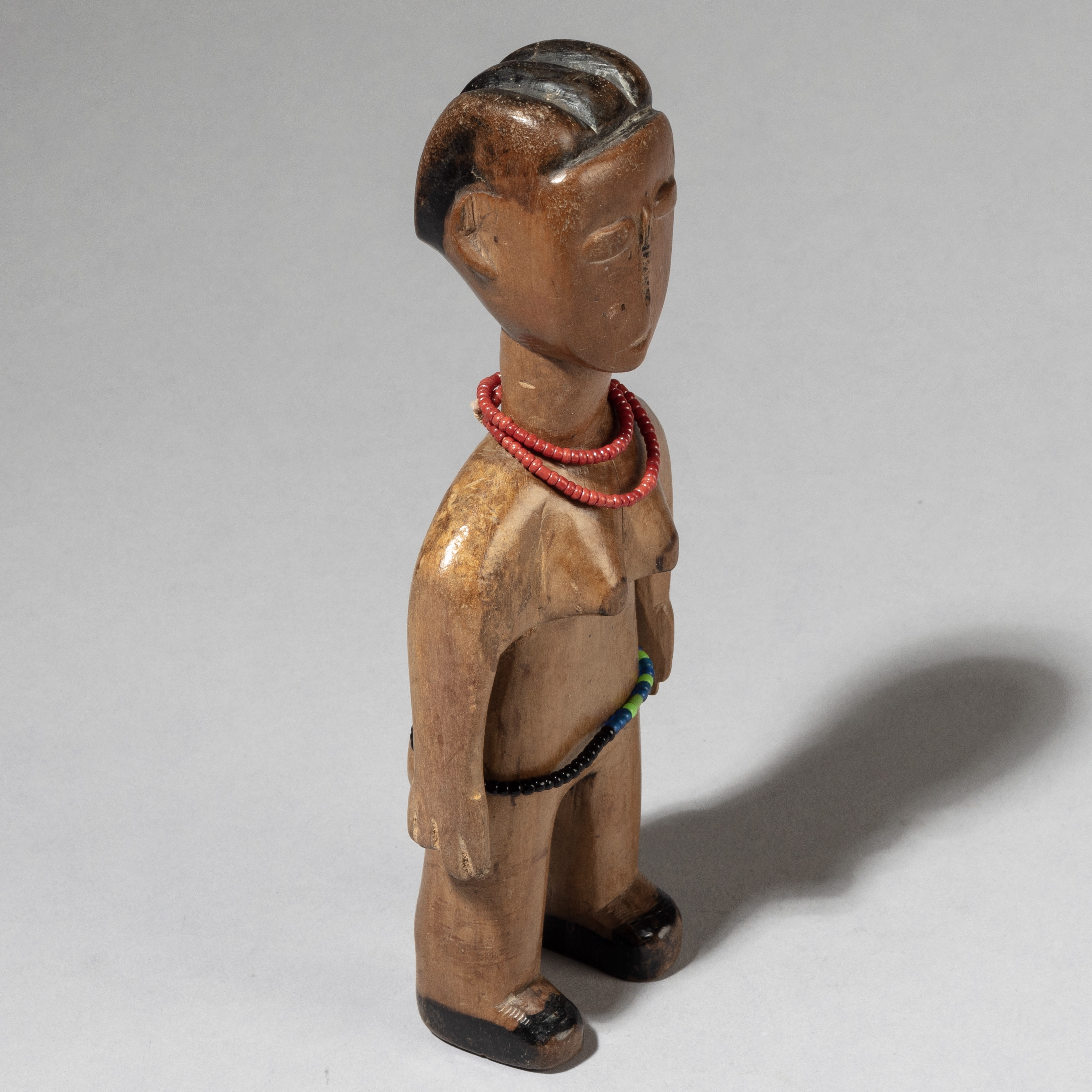 A BEAUTIFULLY PATINATED VENAVI DOLL WEARING A RED BEAD NECKLACE, EWE TRIBE GHANA ( No 3476 )
