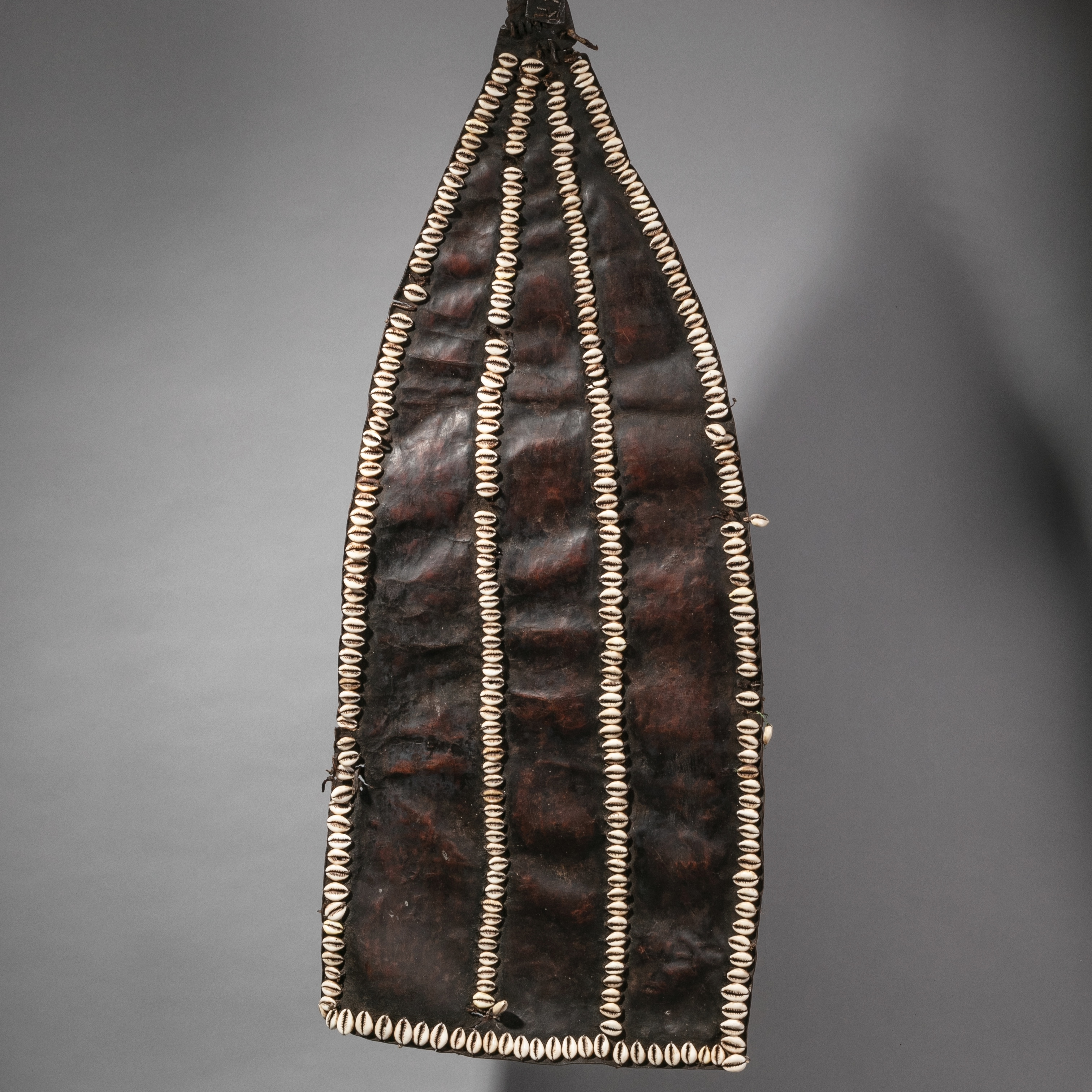 AN UNUSUAL LEATHER + COWRIE TRAIN FROM THE KONSO TRIBE OF ETHIOPIA( No 2236 )