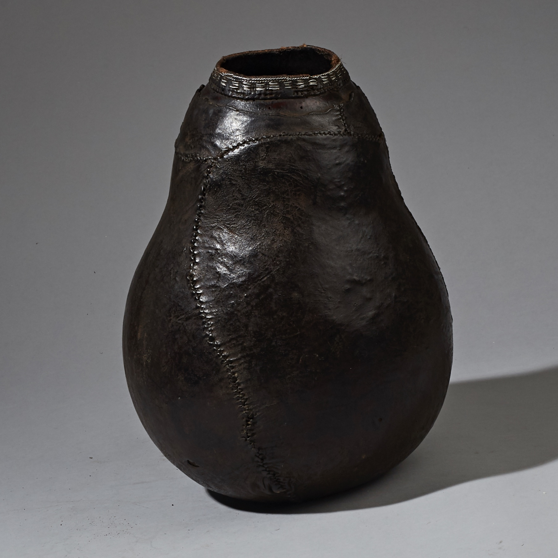 A LARGE LEATHER COVERED GOURD CONTAINER FROM BORANA TRIBE ETHIOPIA ( No 2290 )