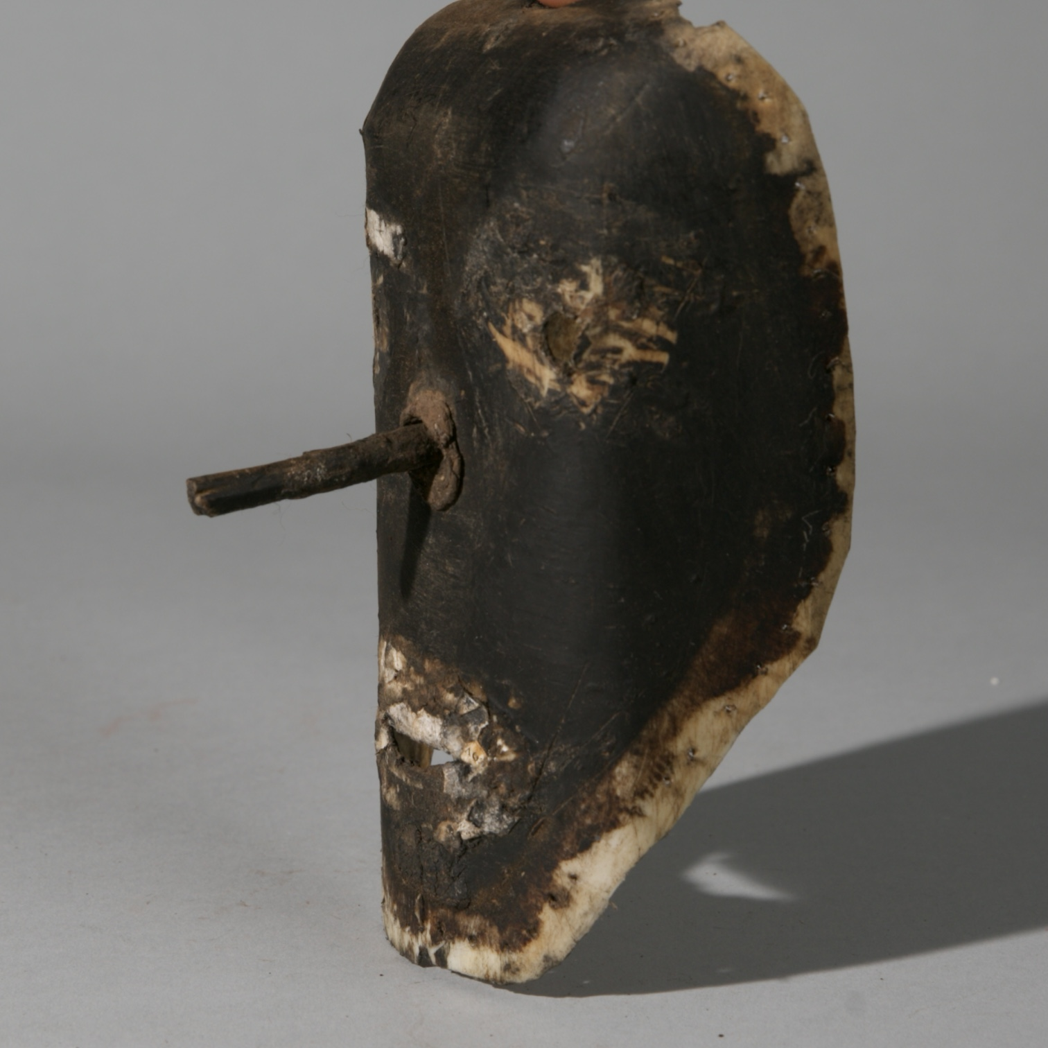 A QUIZZICALLY QUIRKY CHEWA MASK MADE FROM RECYCLED WATER CONTAINER, MALAWI ( No 3979 )