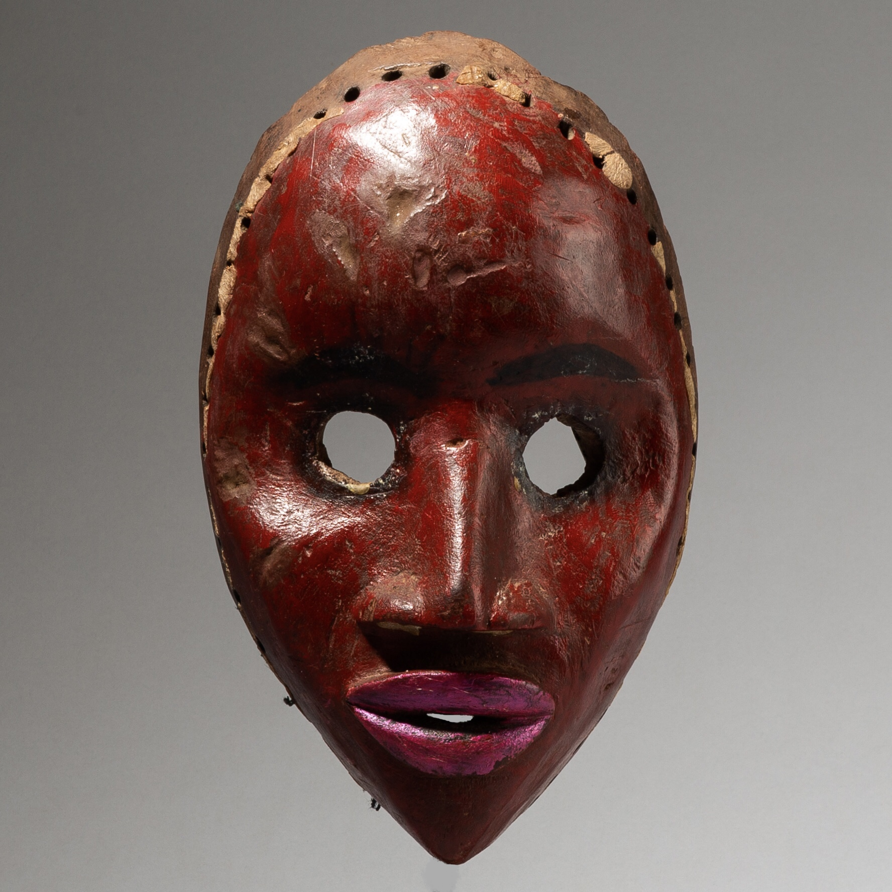 A RED VIVID LIPSTICK DAN MASK FROM THE IVORY COAST W AFRICA  ( No 4071)