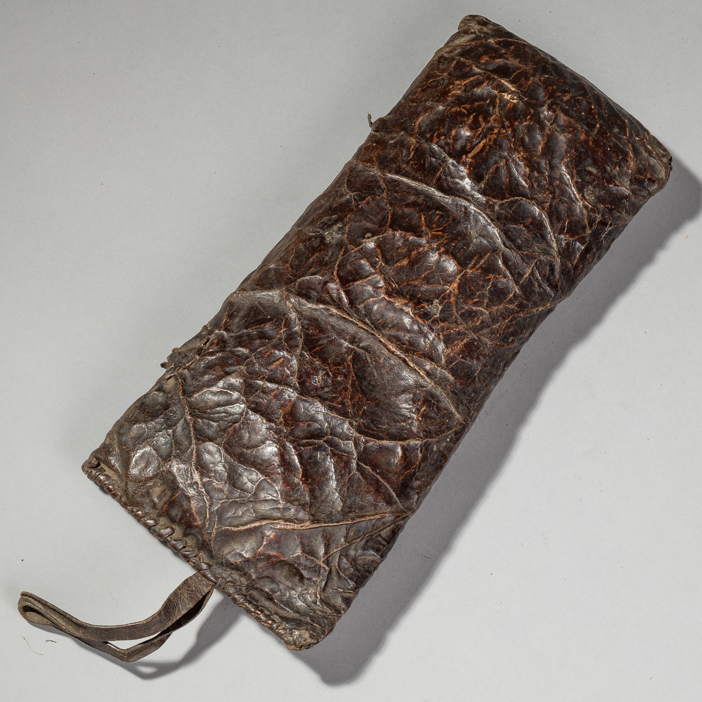 SD A BEAUTIFULLY PATINATED CHOCALATE LEATHER CUSHION FROM ETHIOPIA ( No 1727 )
