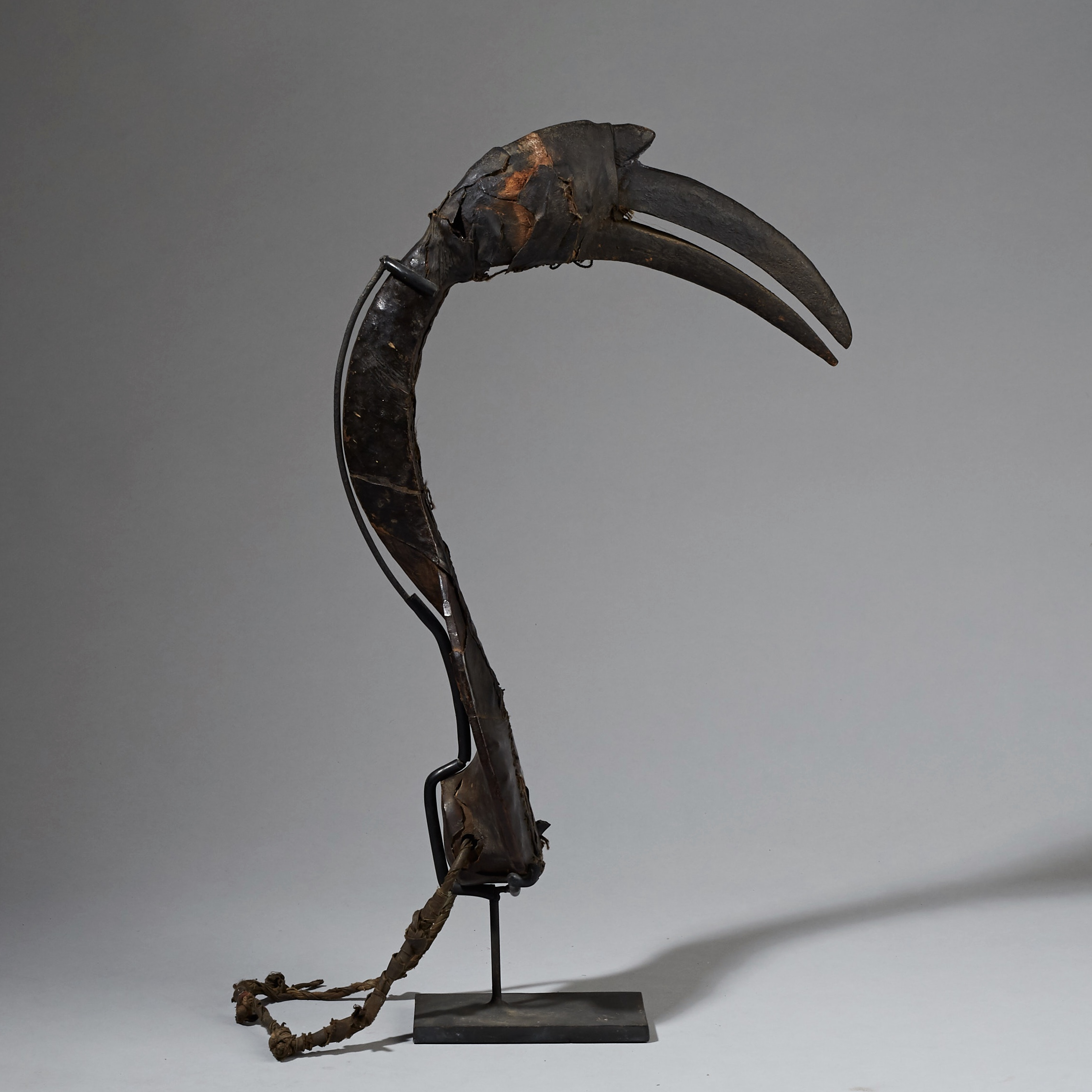 A SCULPTURAL HAUSA DECOY WITH  HANDSTITCHED LEATHER  SHEATH, NIGERIA  ( No 2447 )