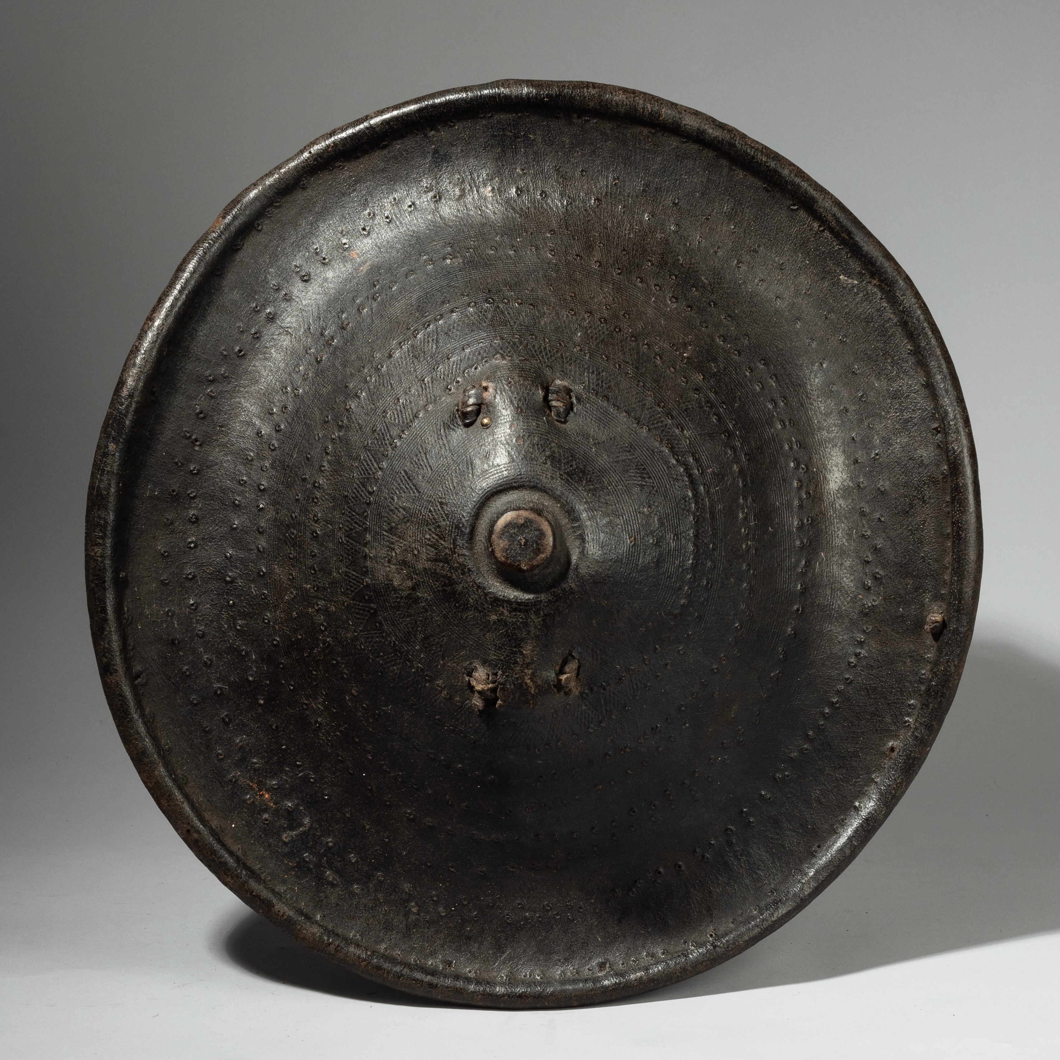 A 19THC EMBOSSED LEATHER SHIELD FROM ETHIOPIA ( No 4235)