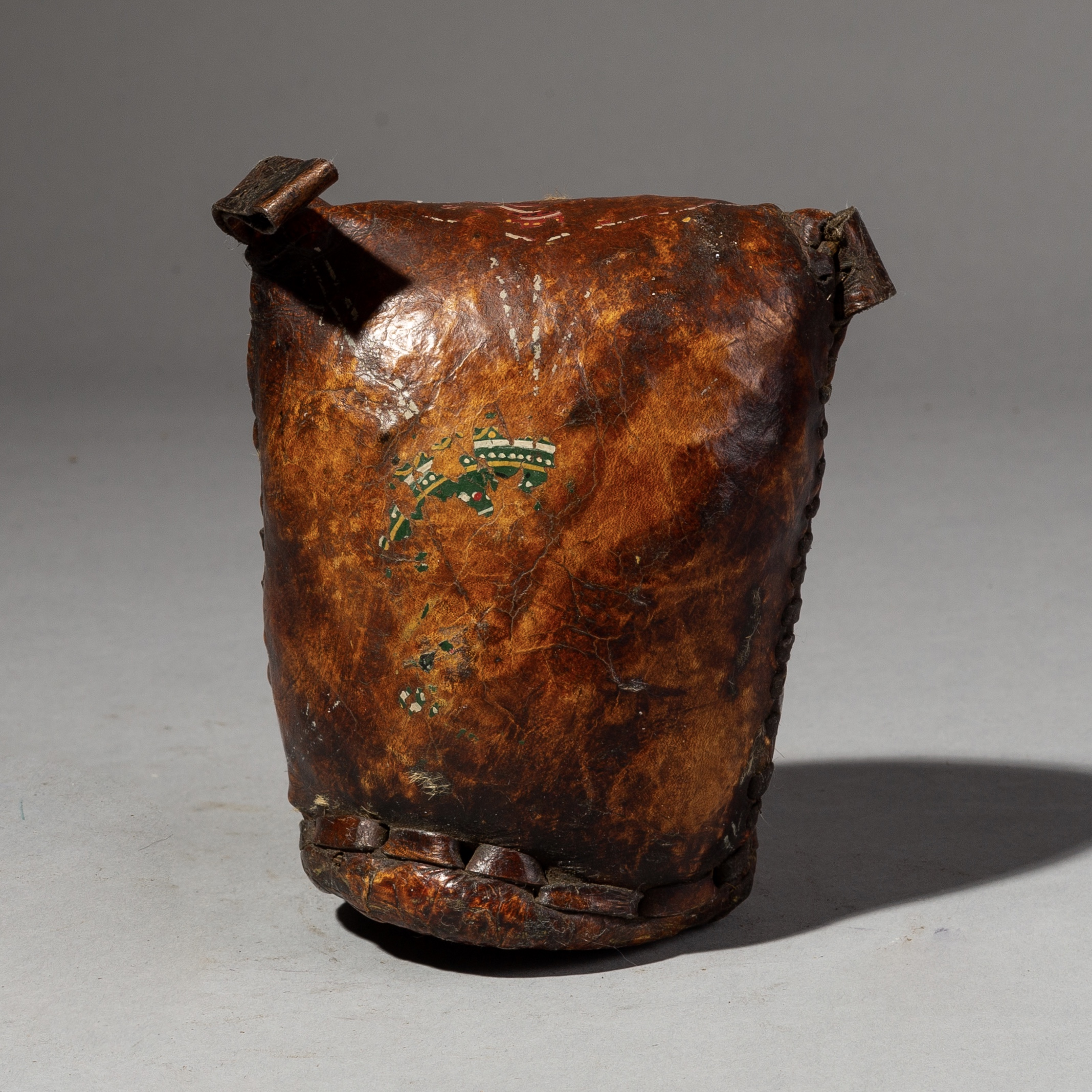 A WORN LEATHER HEADREST FROM ETHIOPIA ( No 2709 )