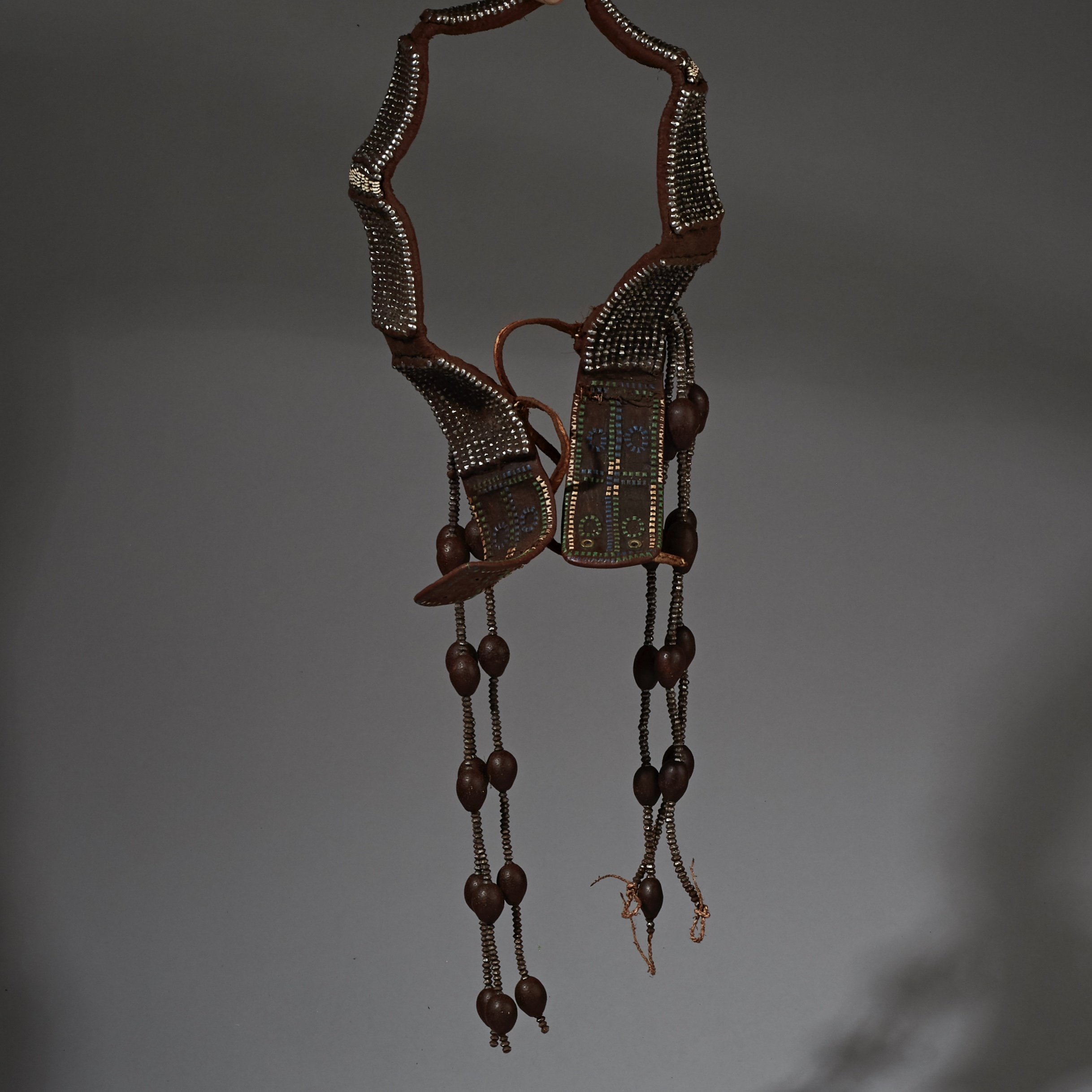 AN ELABORATE HIMBA SEED, METAL, LEATHER + OSTRICH SHELL BELT FROM NAMIBIA ( No 1931 ) ( No 2321 )