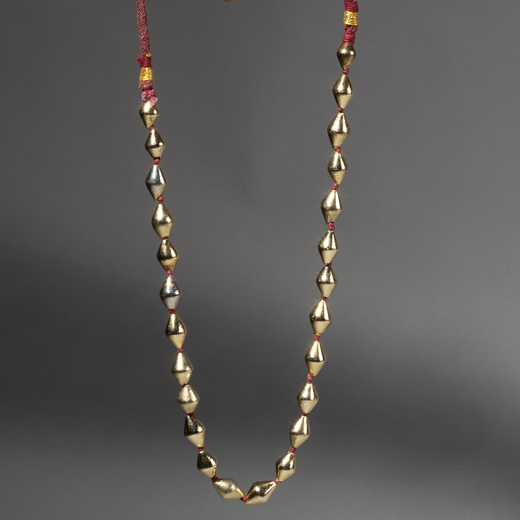 AN ELEGANT GUILDED GOLD NECKLACE WITH BICONE BEADS FROM AFGANISTAN ( No 2250 )