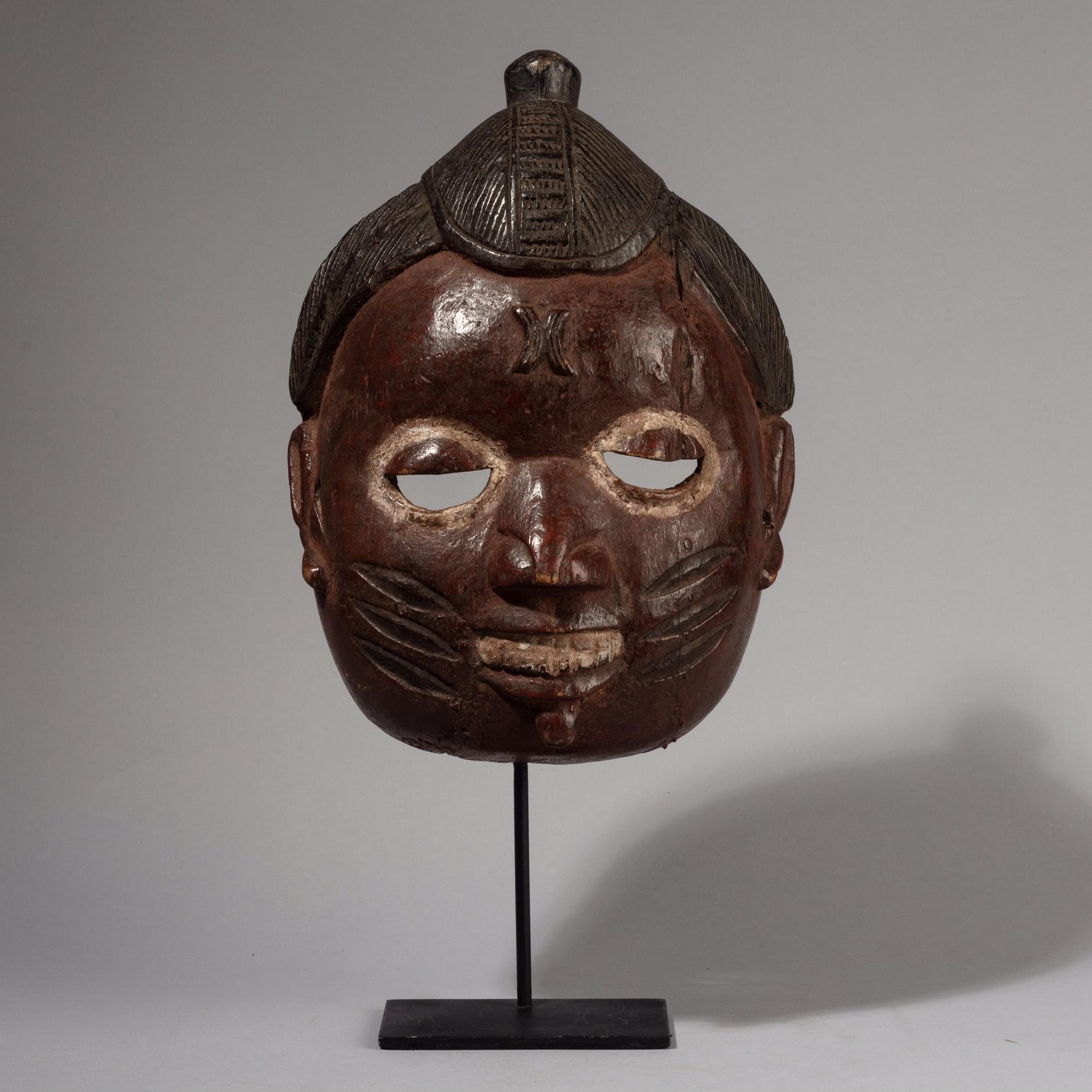 A REFINED YORUBA CEREMONIAL MASK WITH SCARIFIED CHEEKS, NIGERIA W. AFRICA ( No 4380)