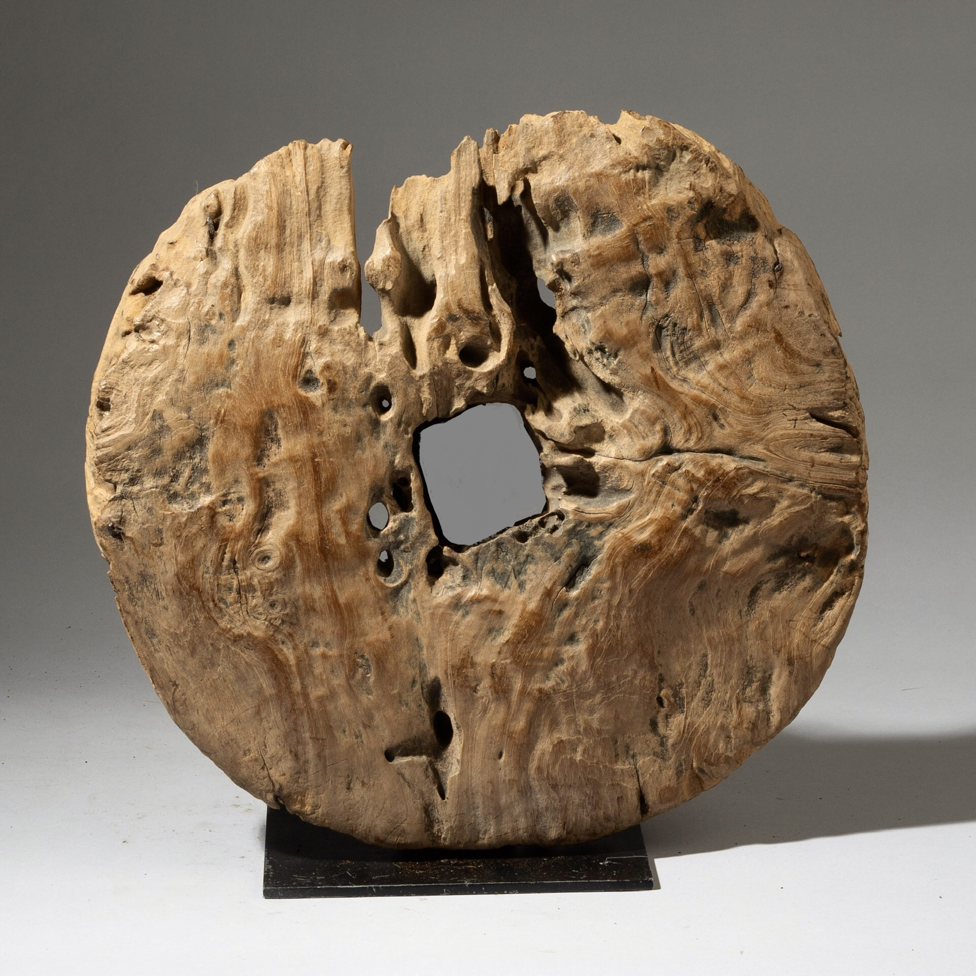 AN ERODED WOODEN COG WITH A SENSE OF THE ARCHAIC, INDONESIA ( No 3113 )
