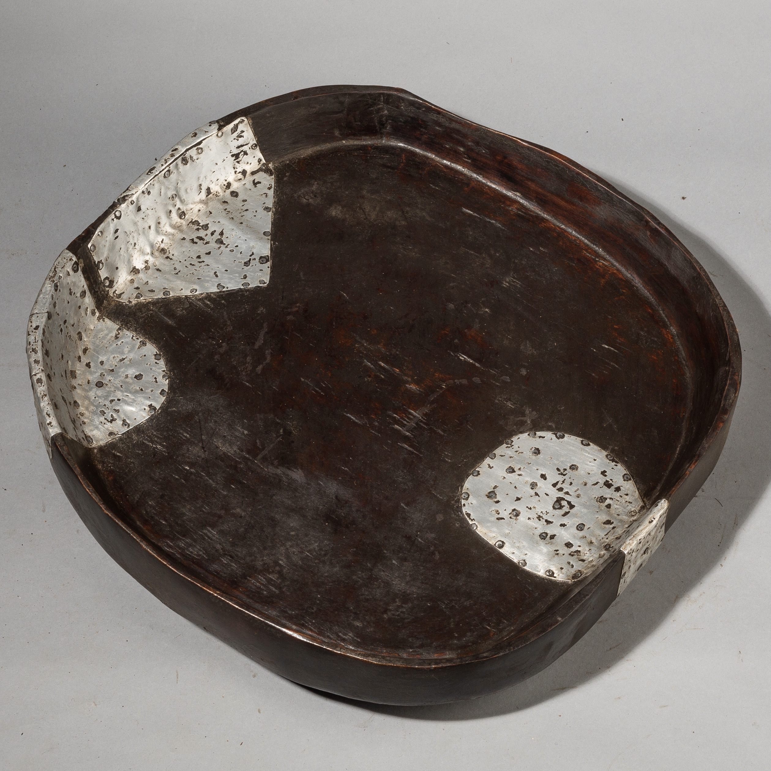 A PRACTICAL WOODEN TRAY WITH METAL REPAIRS, TANZANIA ( No 3677)