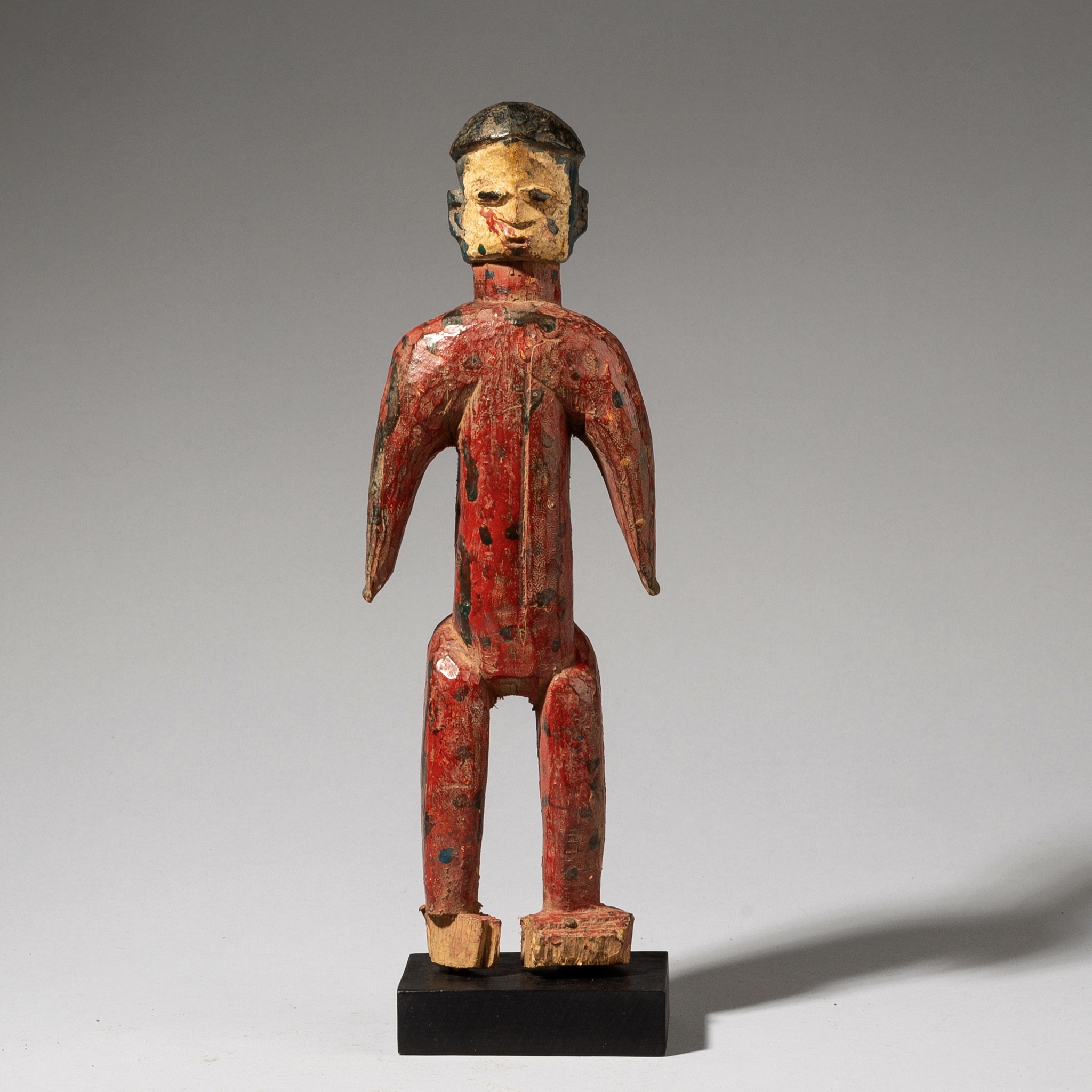 A RED ALTAR FIGURE FROM THE EWE TRIBE GHANA  ( No 3689)