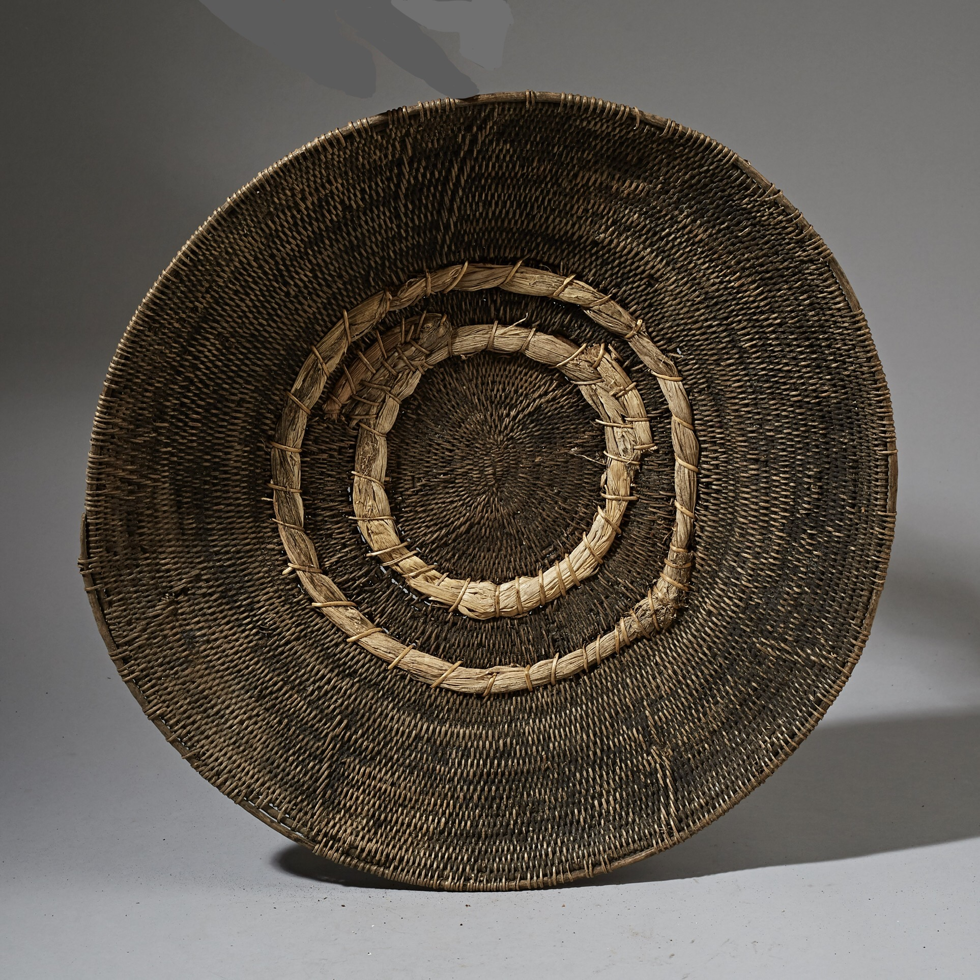 AN ARTISTIC LARGE  BASKET WITH INDIGENOUS REPAIRS FROM ZAMBIA ( No 2567 )