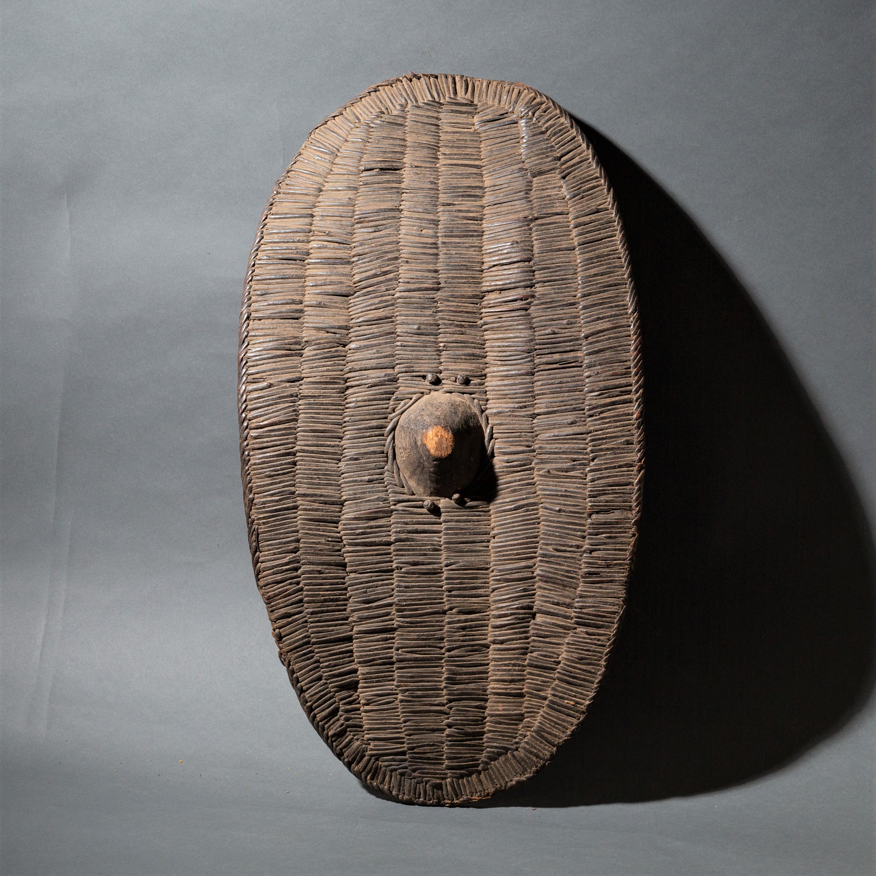A WOVEN FIBRE SHIELD FROM UGANDA ( No 255 )