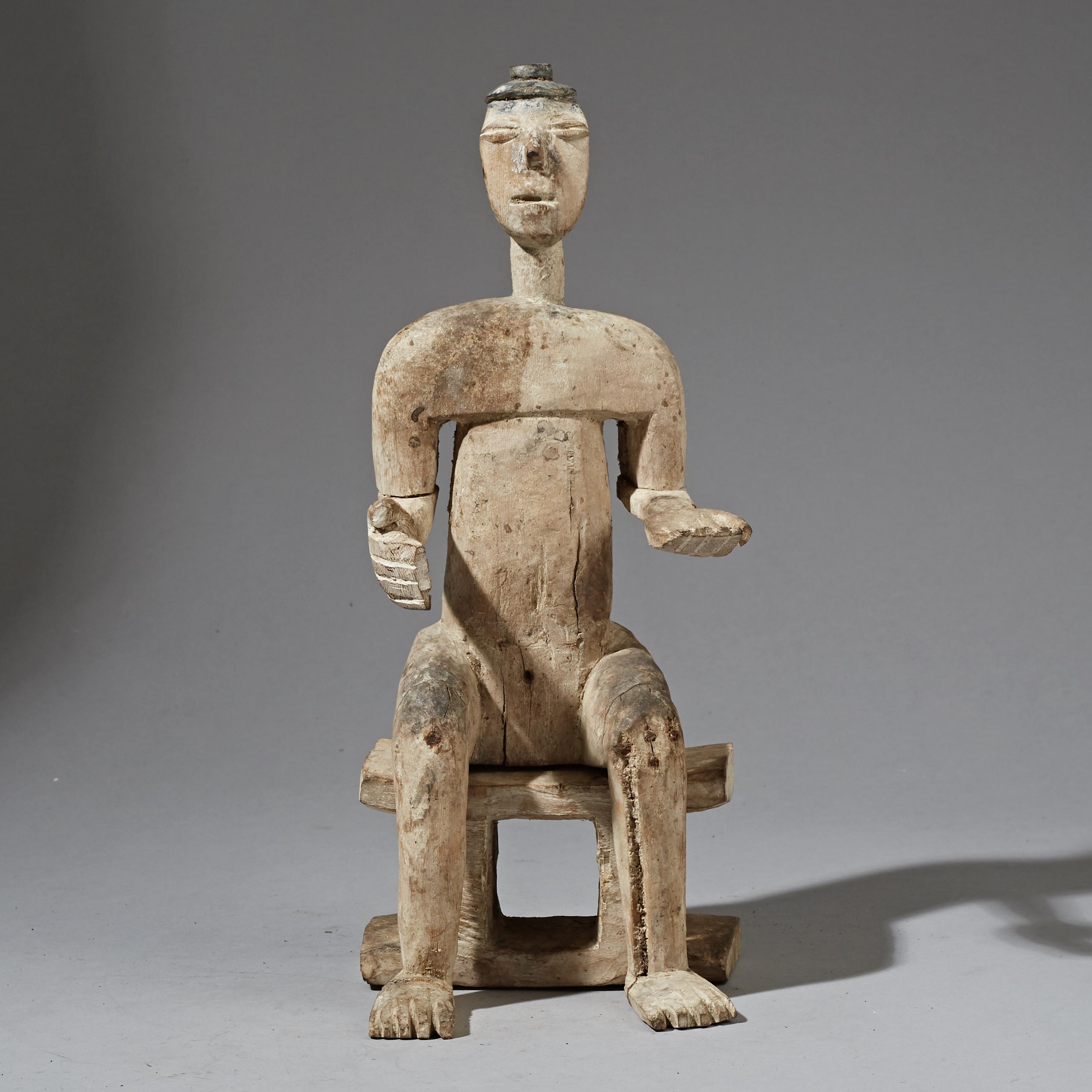A ELEGANT SEATED EWE TRIBE STATUE FROM GHANA ( No 2298 )