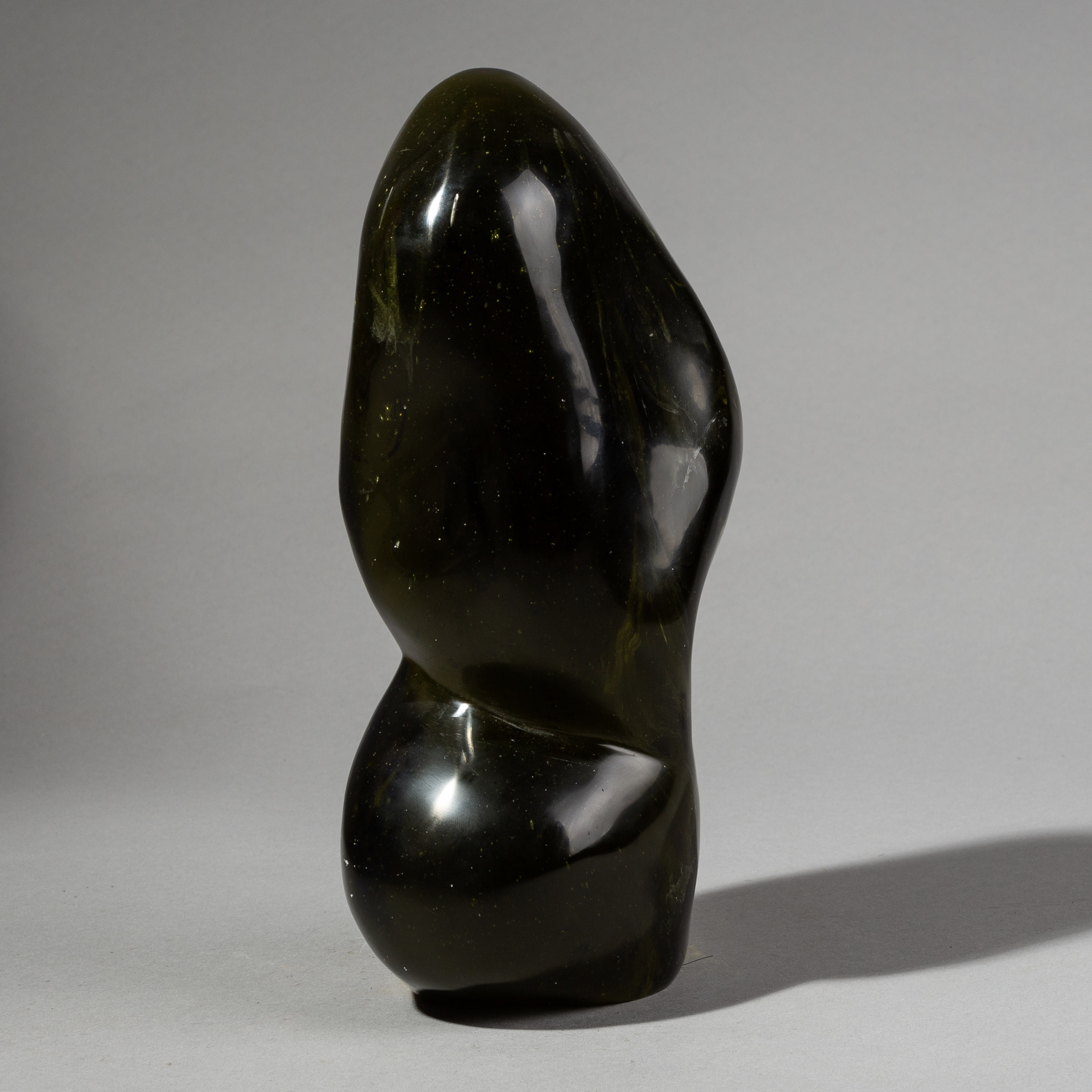 AN EVOCATIVE DARK GREEN MADAGASCAN GLASS SCULPTURE ( No 2240 )