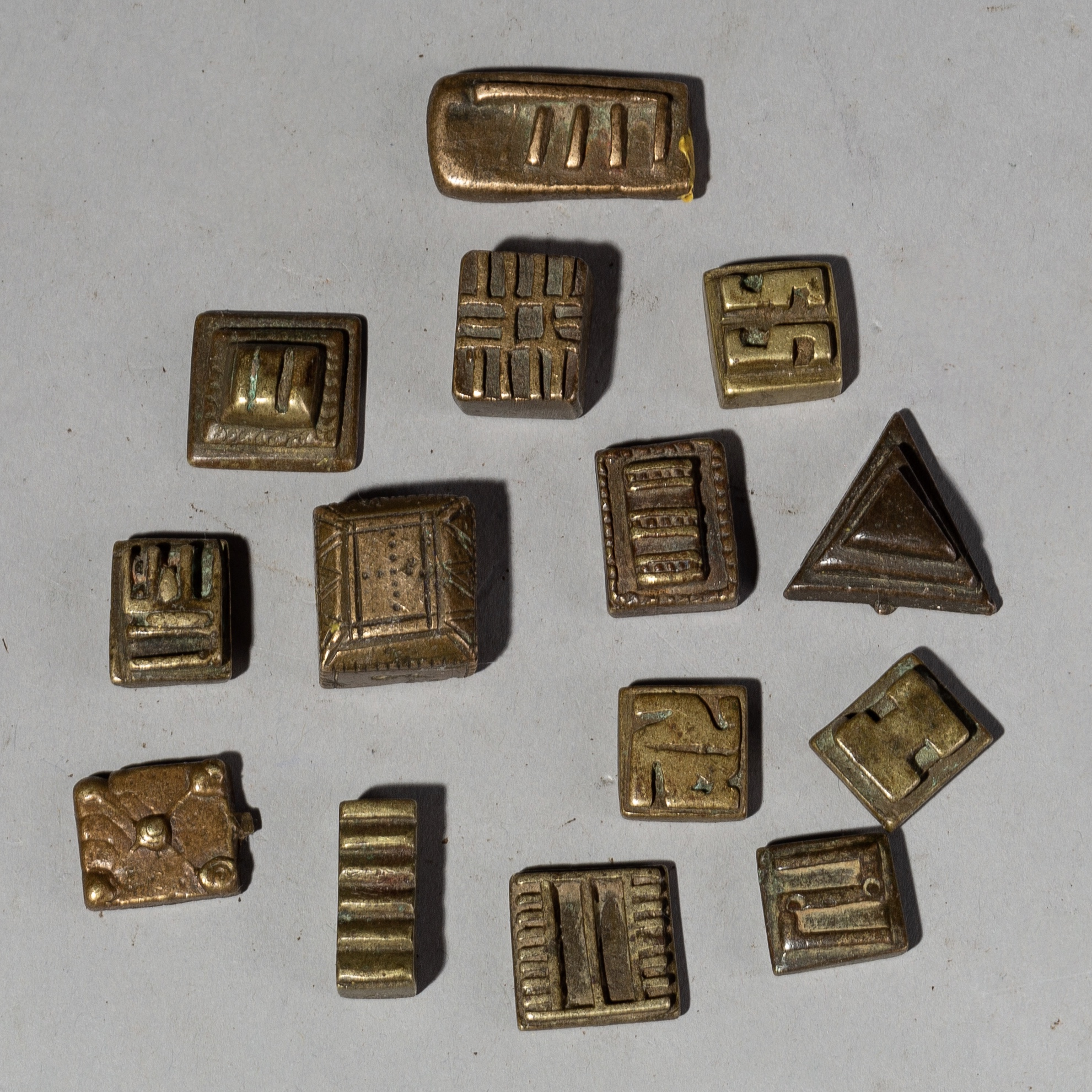 ( SOLD- LY ) AN ECLECTIC  GROUP OF 14 MEDIUM SIZED AKAN GOLD WEIGHTS( No 2018 )