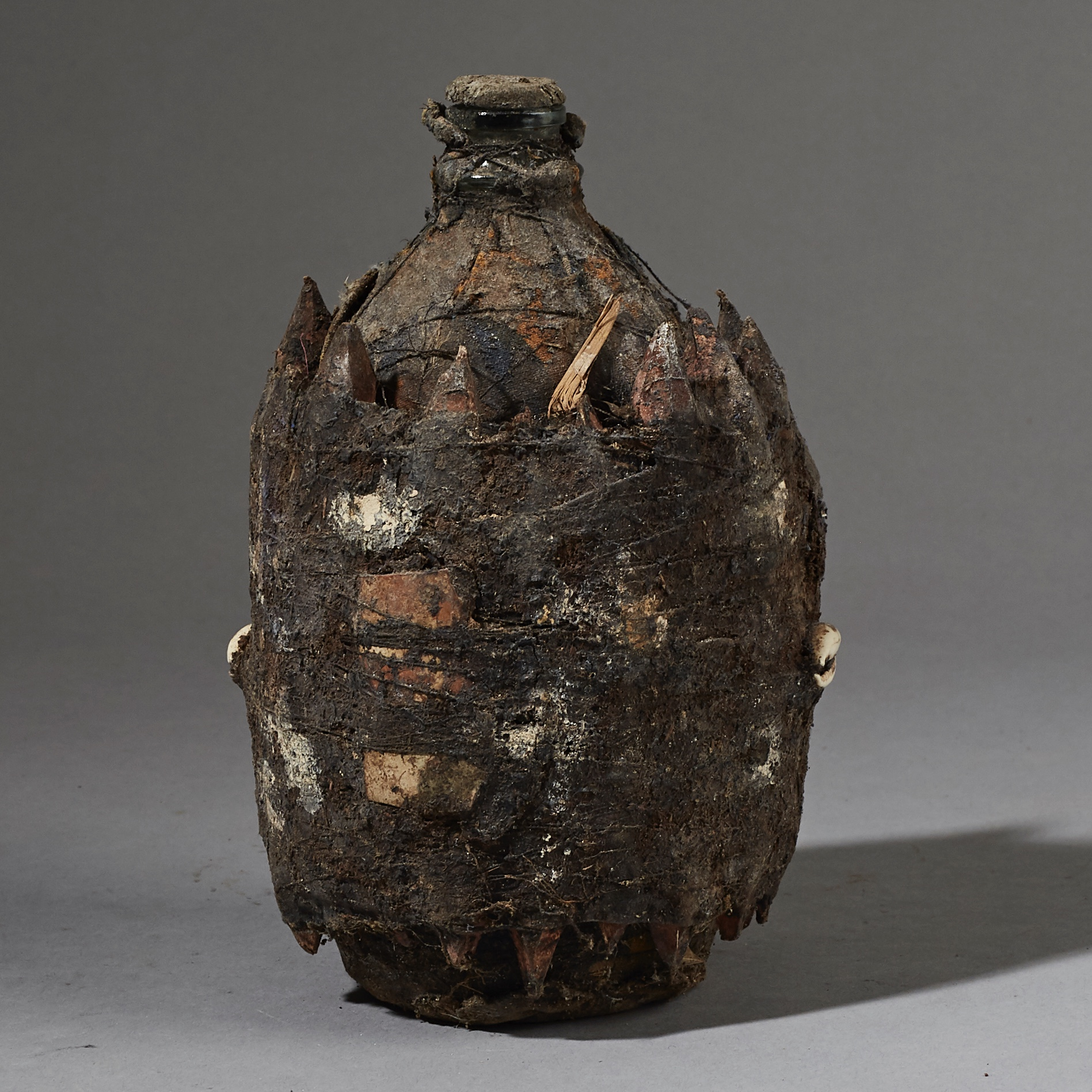 A WRAPPED BOTTLE FETISH FROM FON TRIBE OF BENIN ( No 2651)