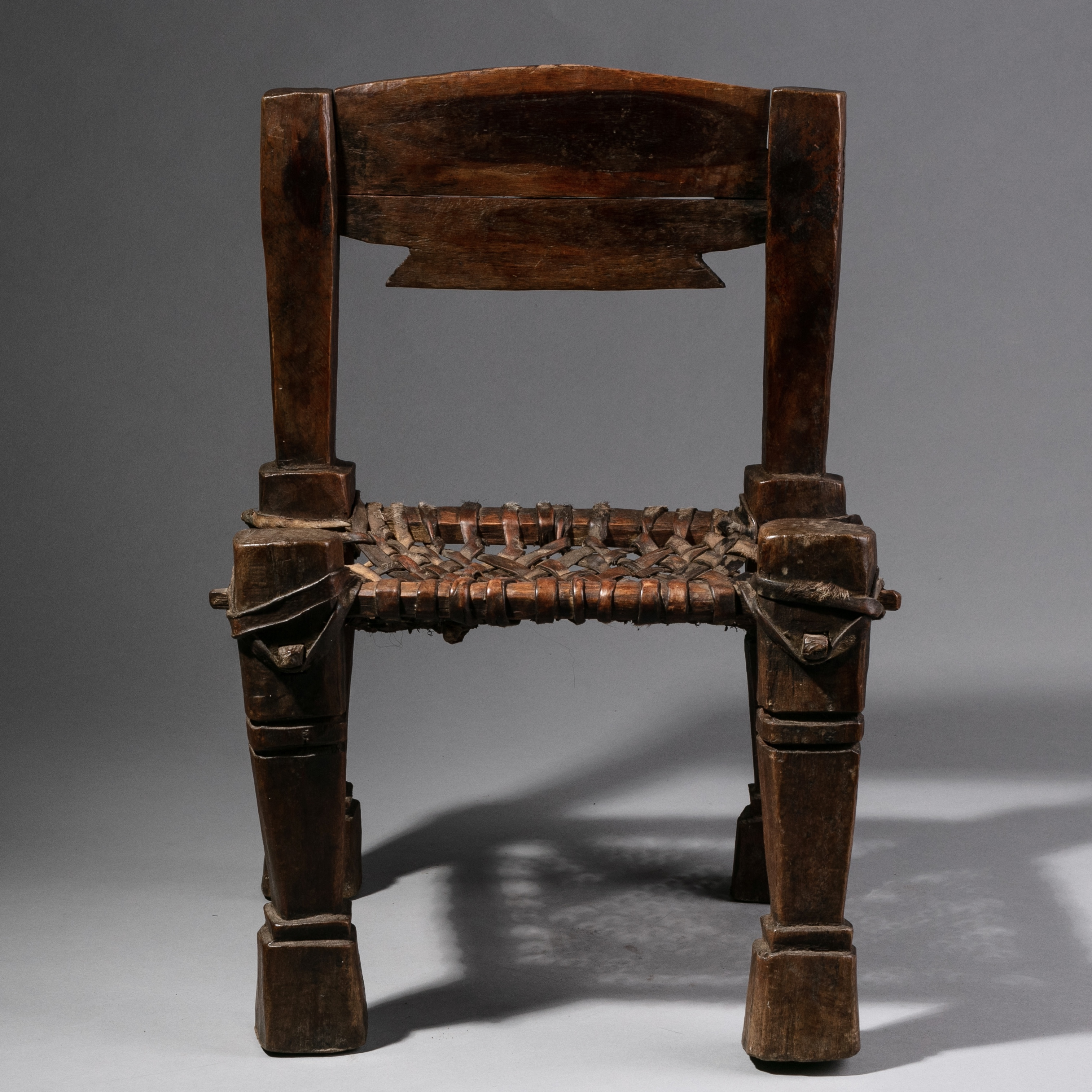 A CHILD SIZED ETHIOPIAN CHAIR WITH WOVEN LEATHER SEAT ( No 1034 )