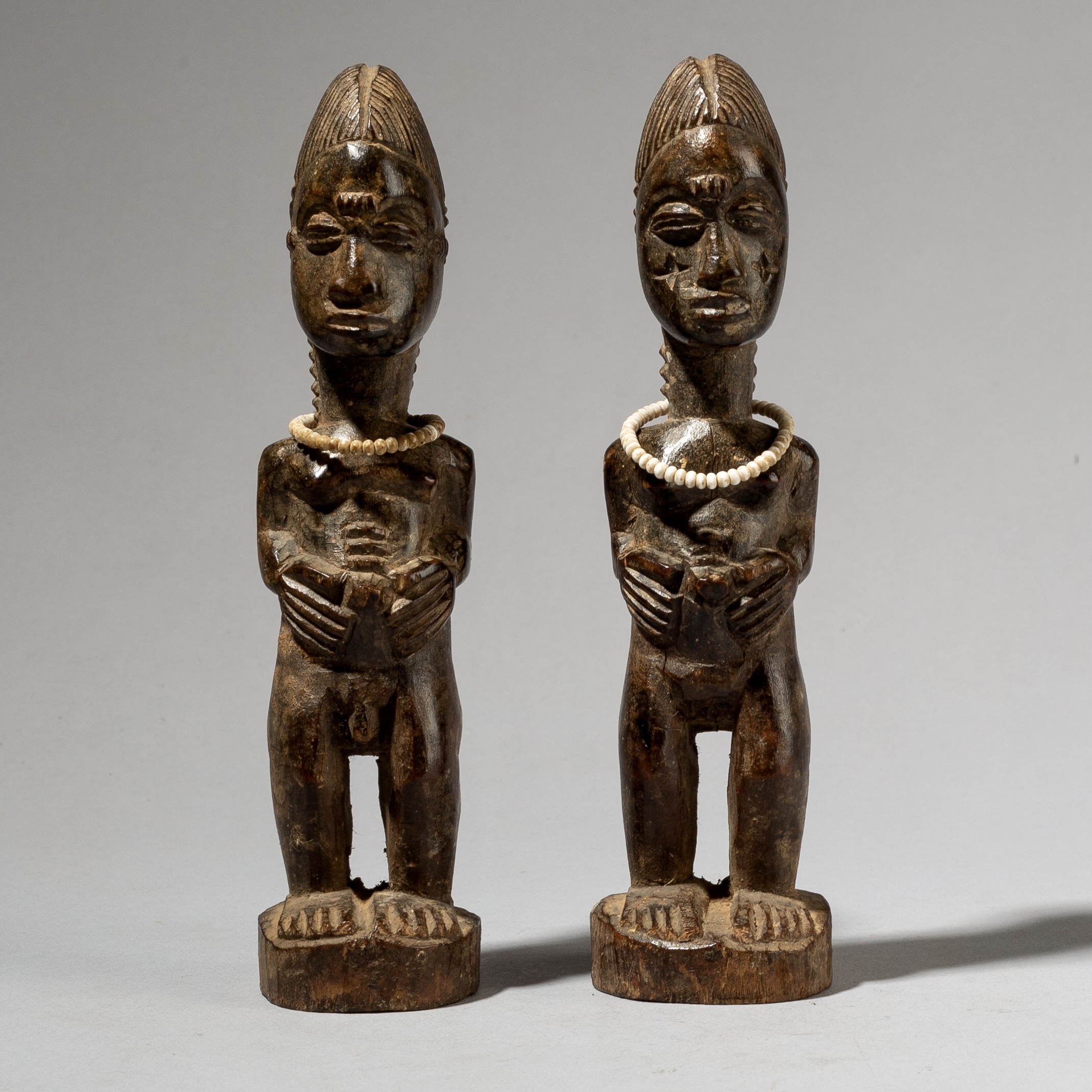 A GRACIOUS PAIR OF BAULE CHARM FIGURES, IVORY COAST W AFRICA ( No 4082)