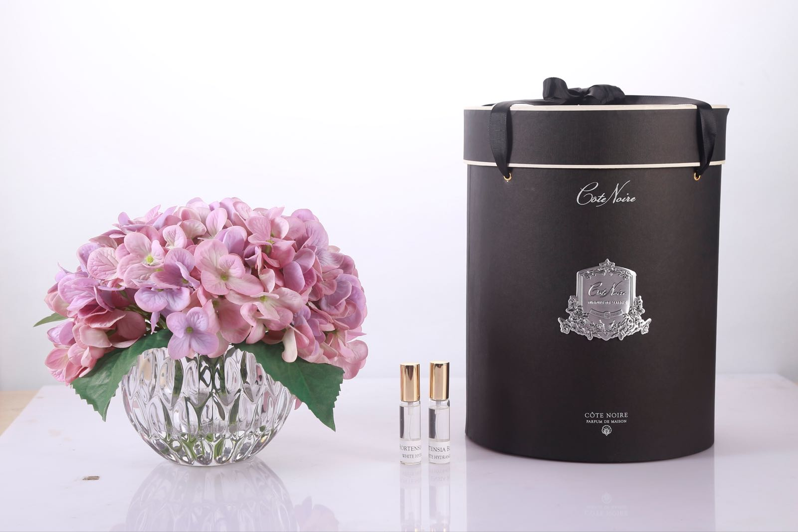 Cote noire fragranced Pink Hydrangea with hat box and fragrance in a crystal vase