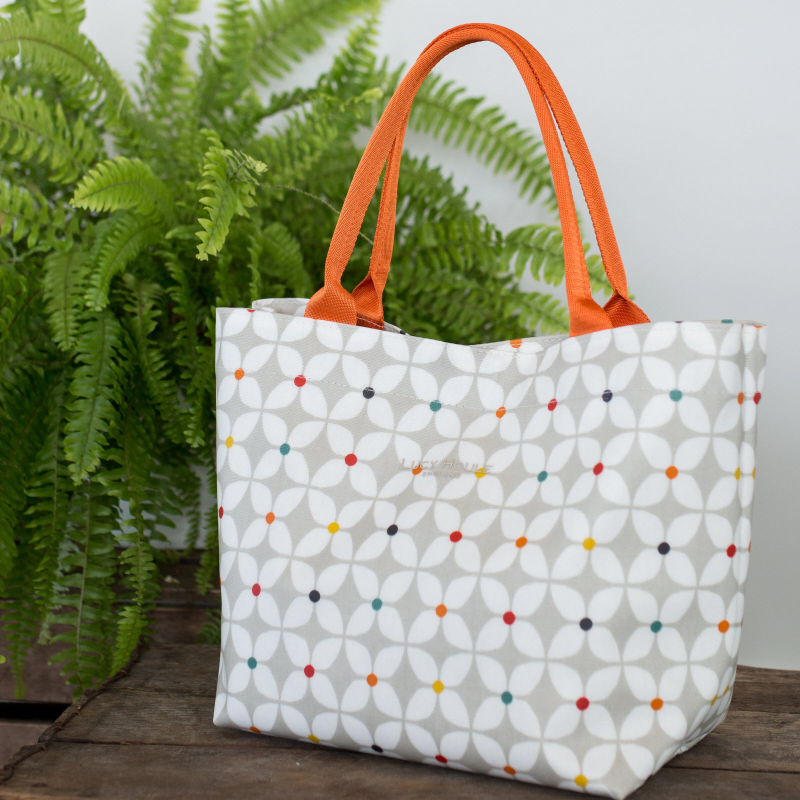 Modern Daisy Taupe Small Grab Bag with Orange Handles
