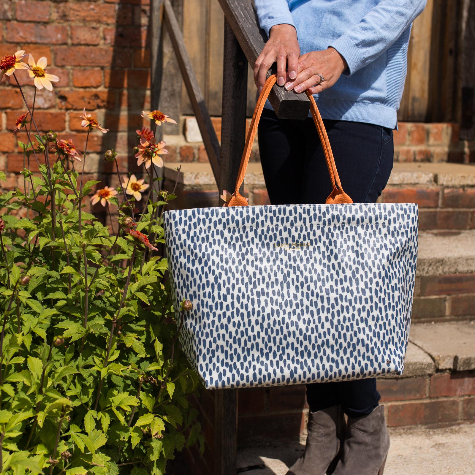 Navy Cobblestone Medium Zip Tote Bag with Orange Handles