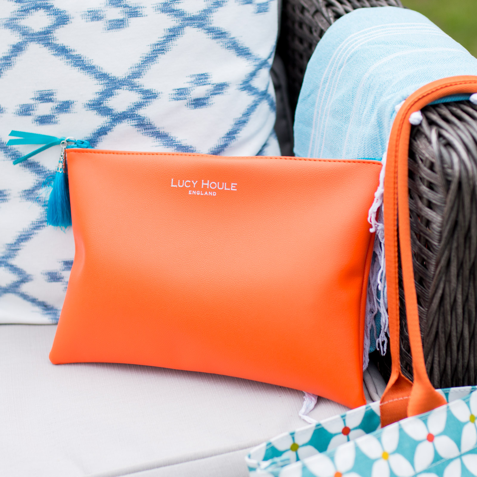 Faux Leather Orange Clutch with Turquoise Tassel