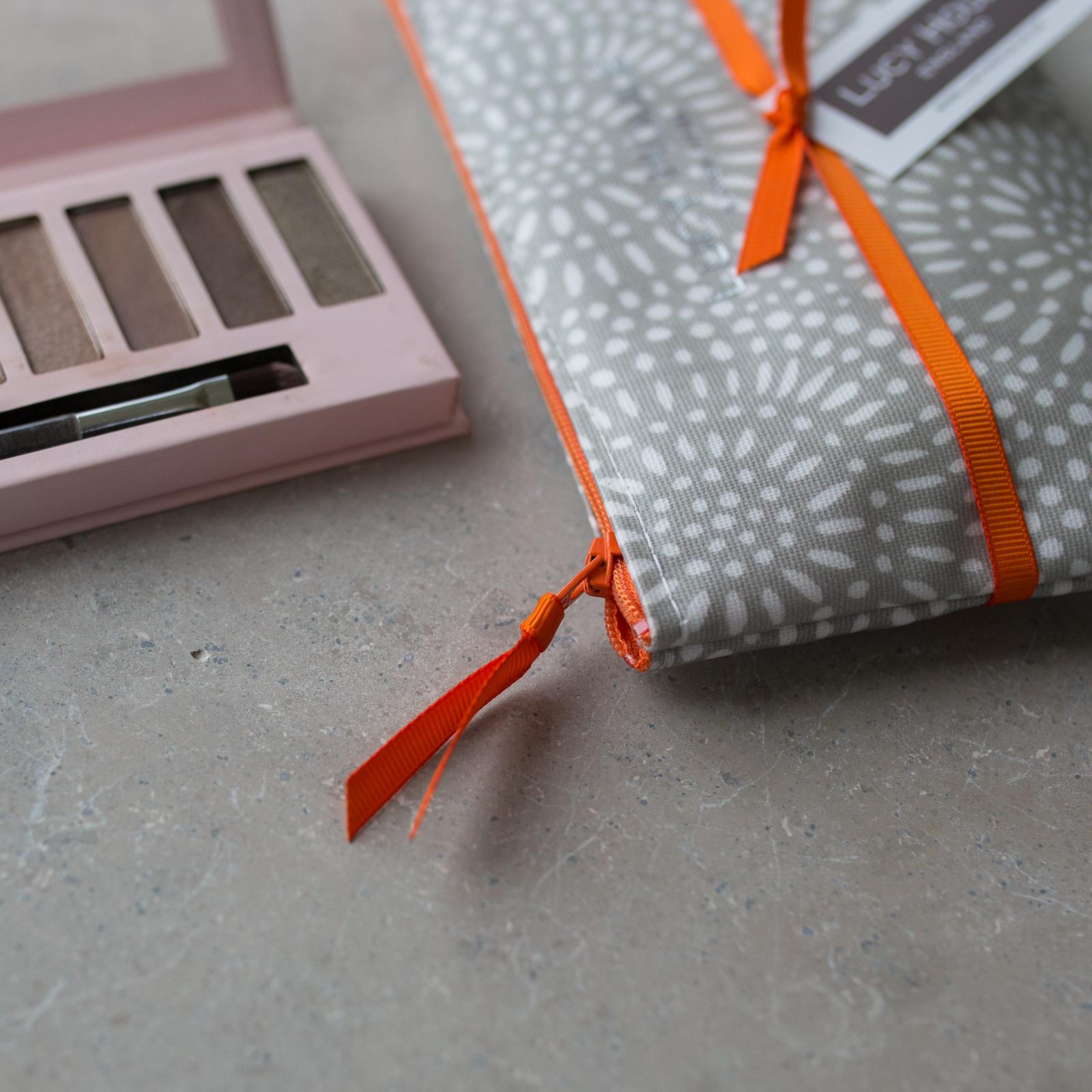 Stone Sunburst  Make-Up Bag with Orange Zip