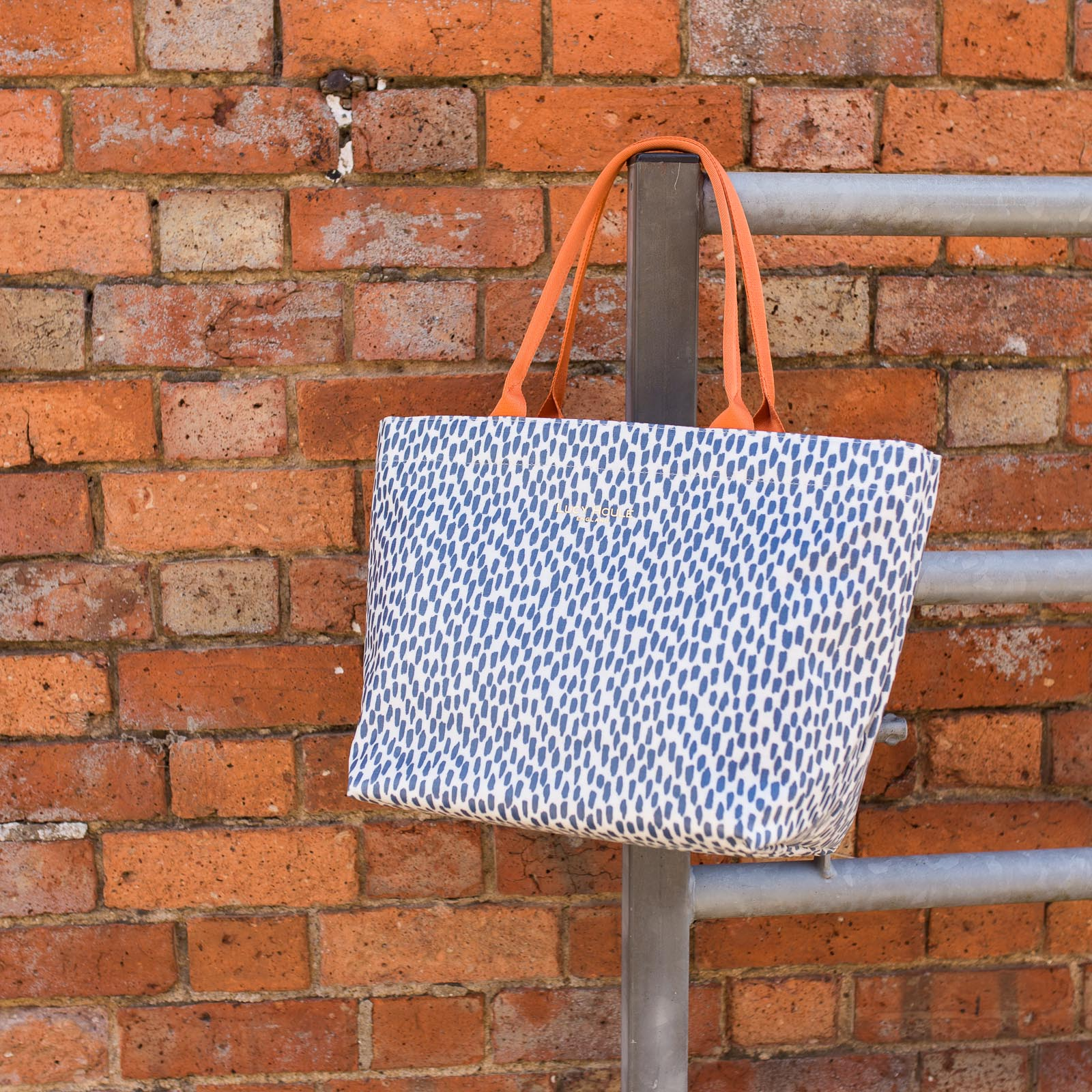 Navy Cobblestone Medium Tote Bag with Orange Handles