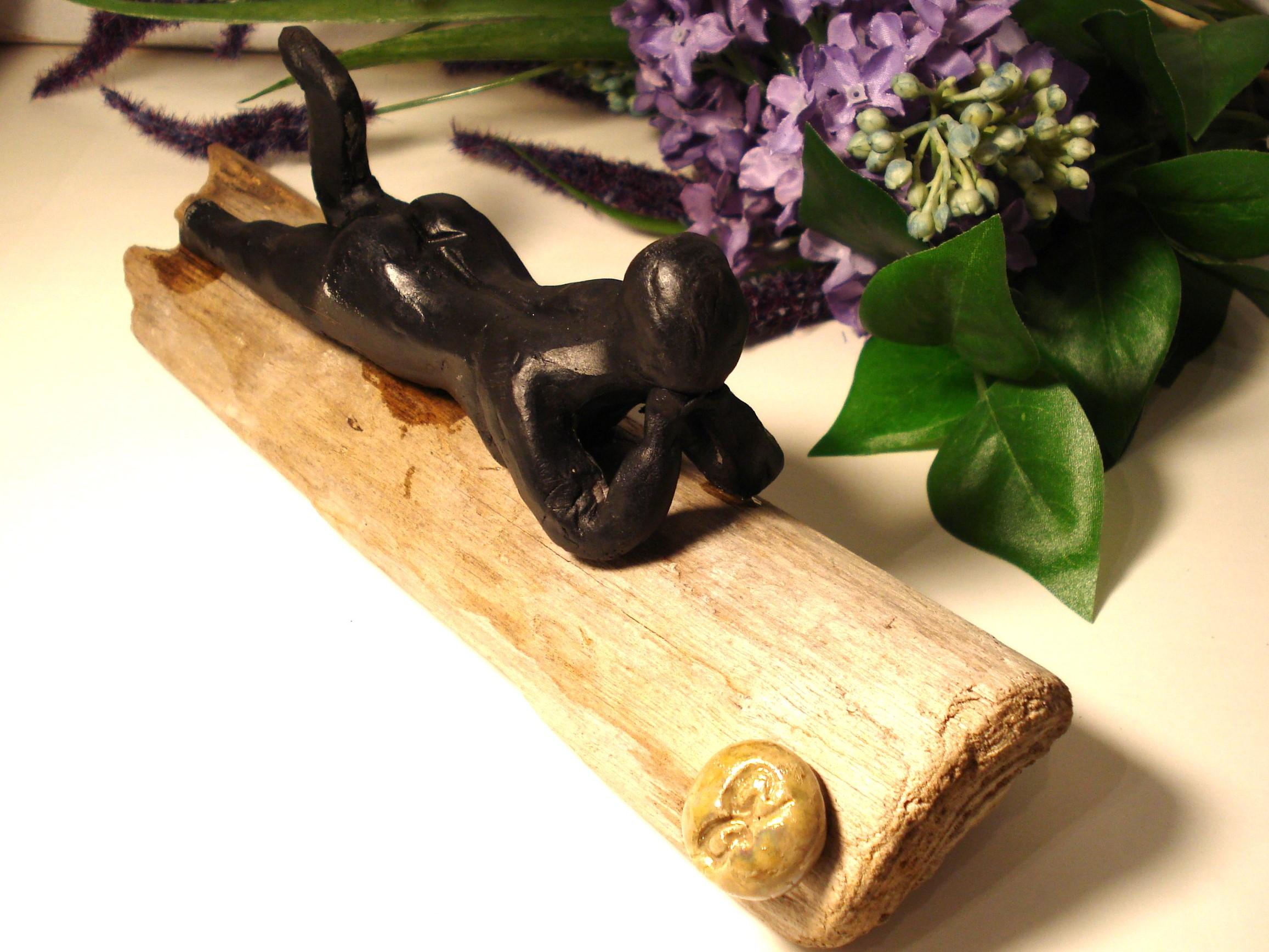 Drivtømmer kvinde i raku