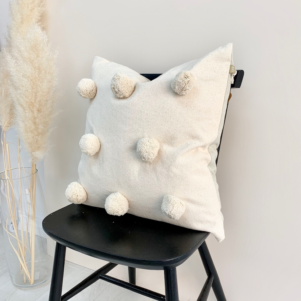 Giant Pom Pom cushion cream