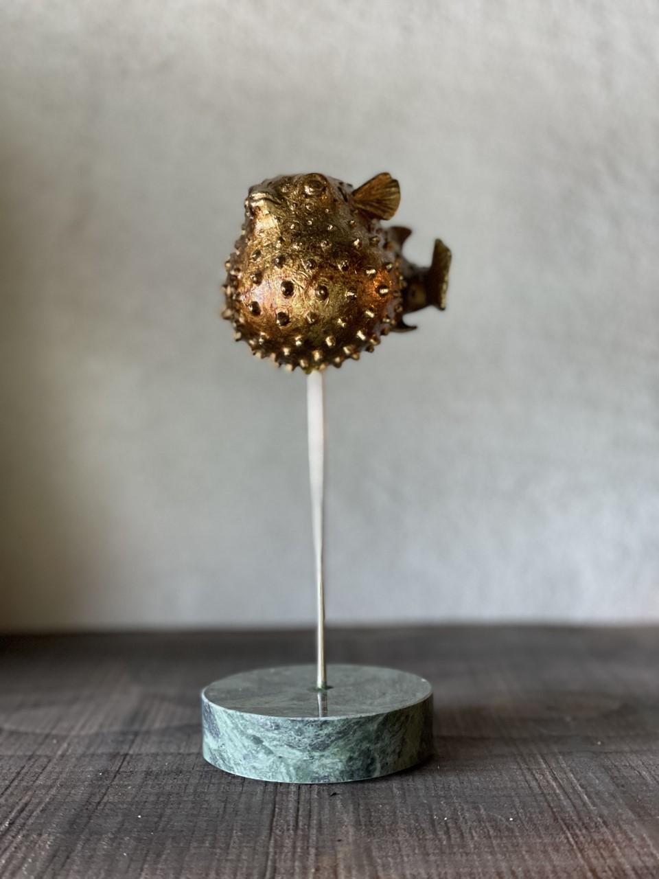 Blåsfisk på marmorbas