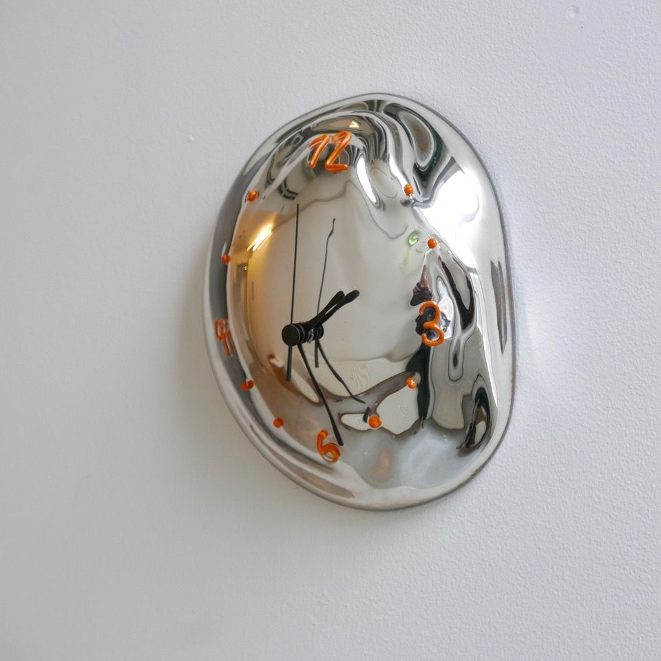 Glass wall clock by Silje Lindrup