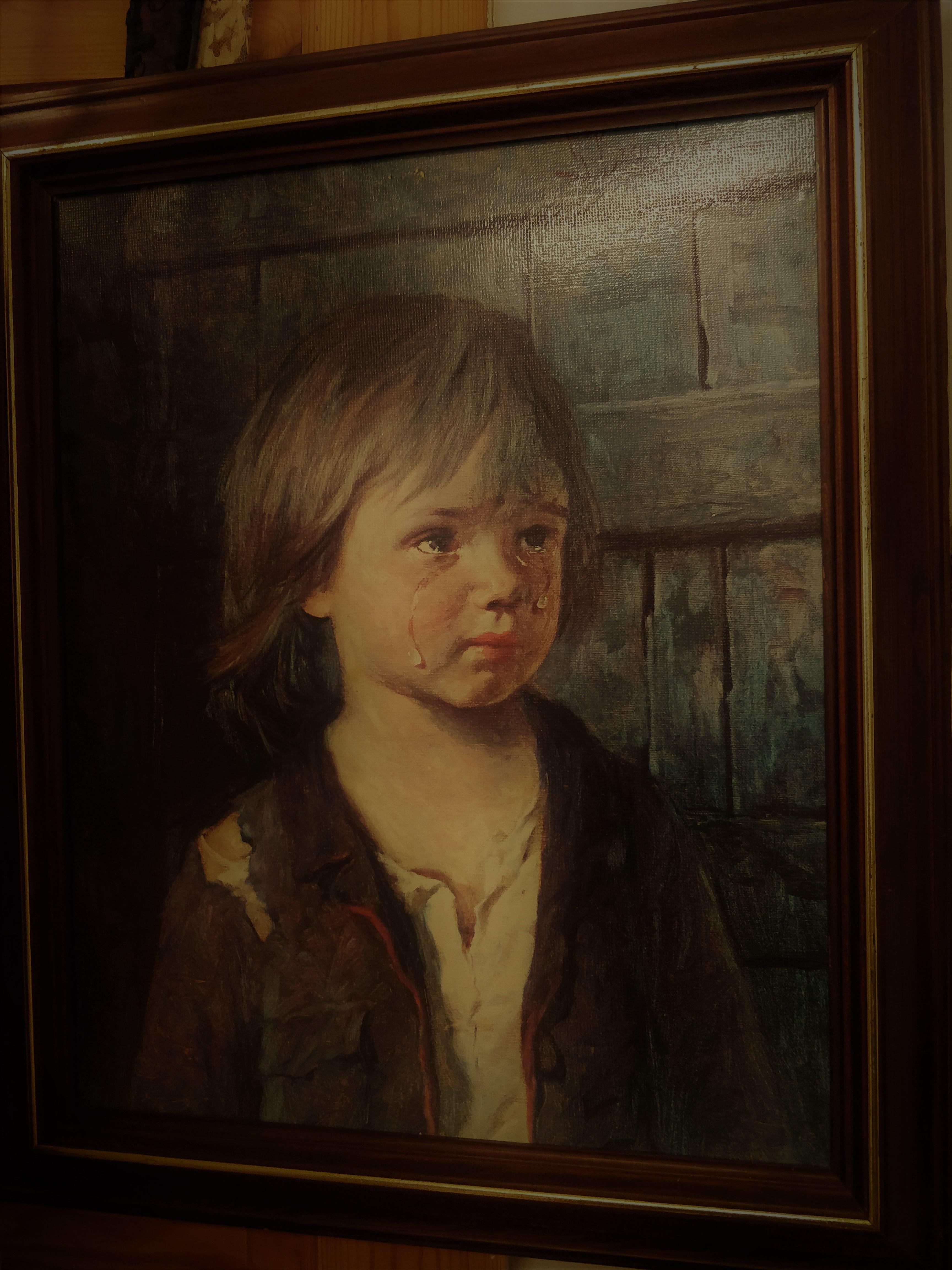 Taulu itkevä poika