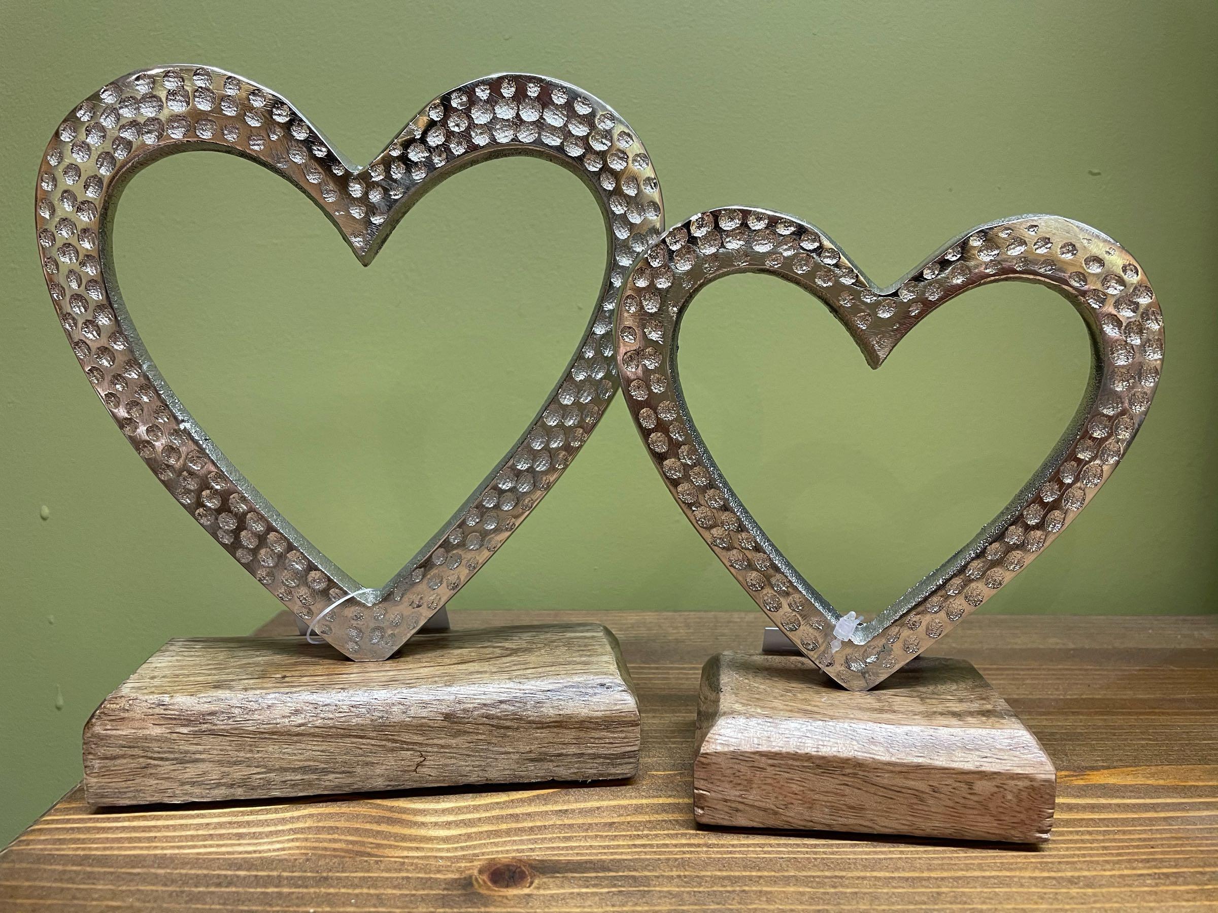 Hammered  aluminium heart on block