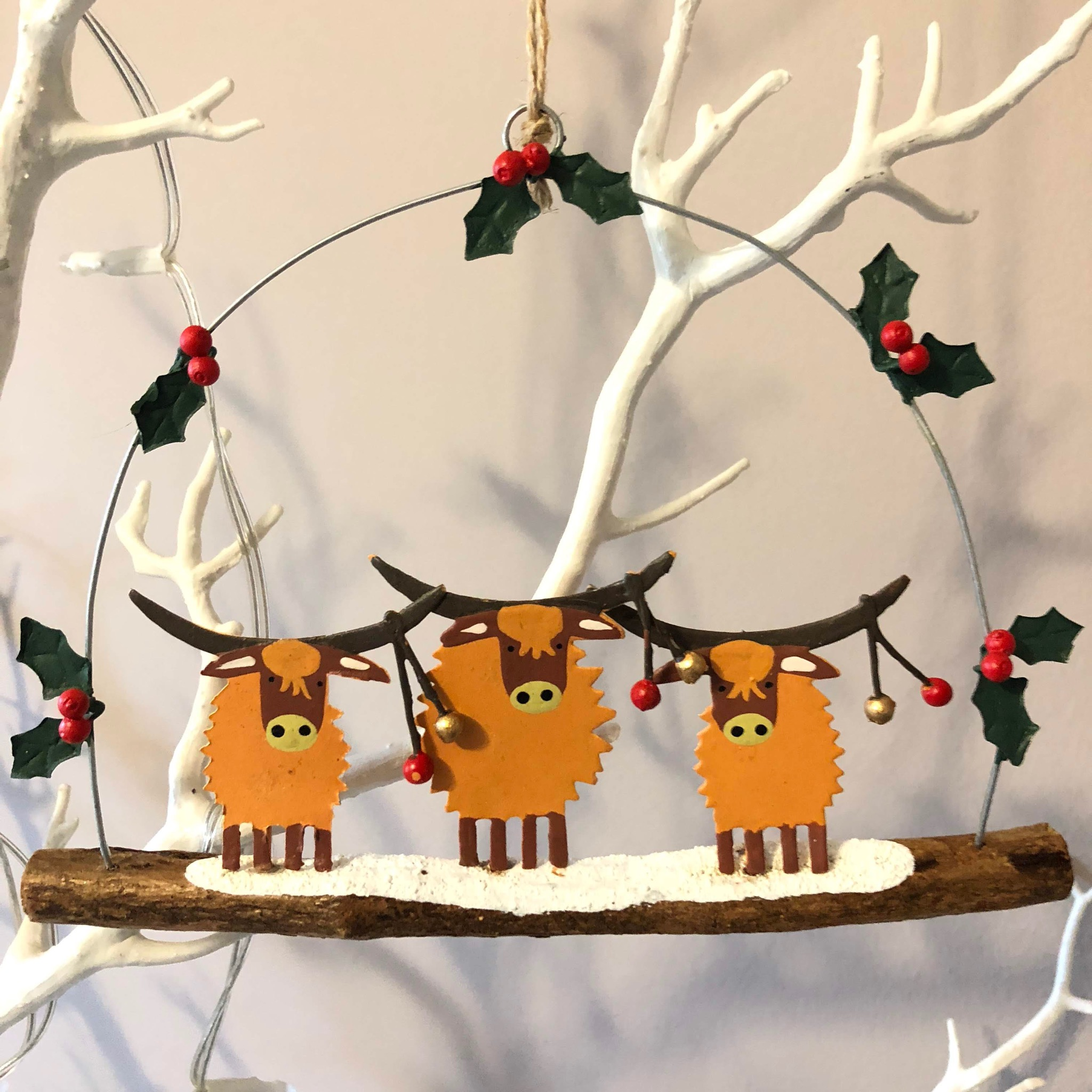 3 highland cows with baubles hanging Christmas decoration by shoeless joe