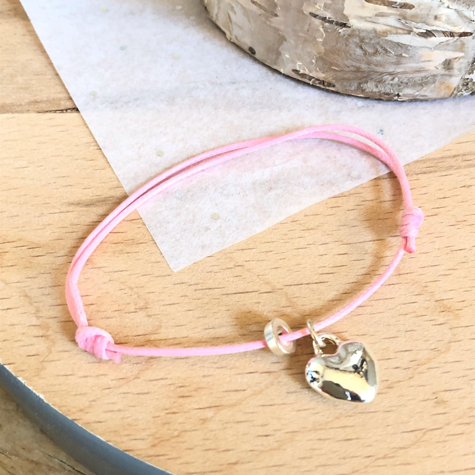 Adjustable cord bracelet heart charm & disc