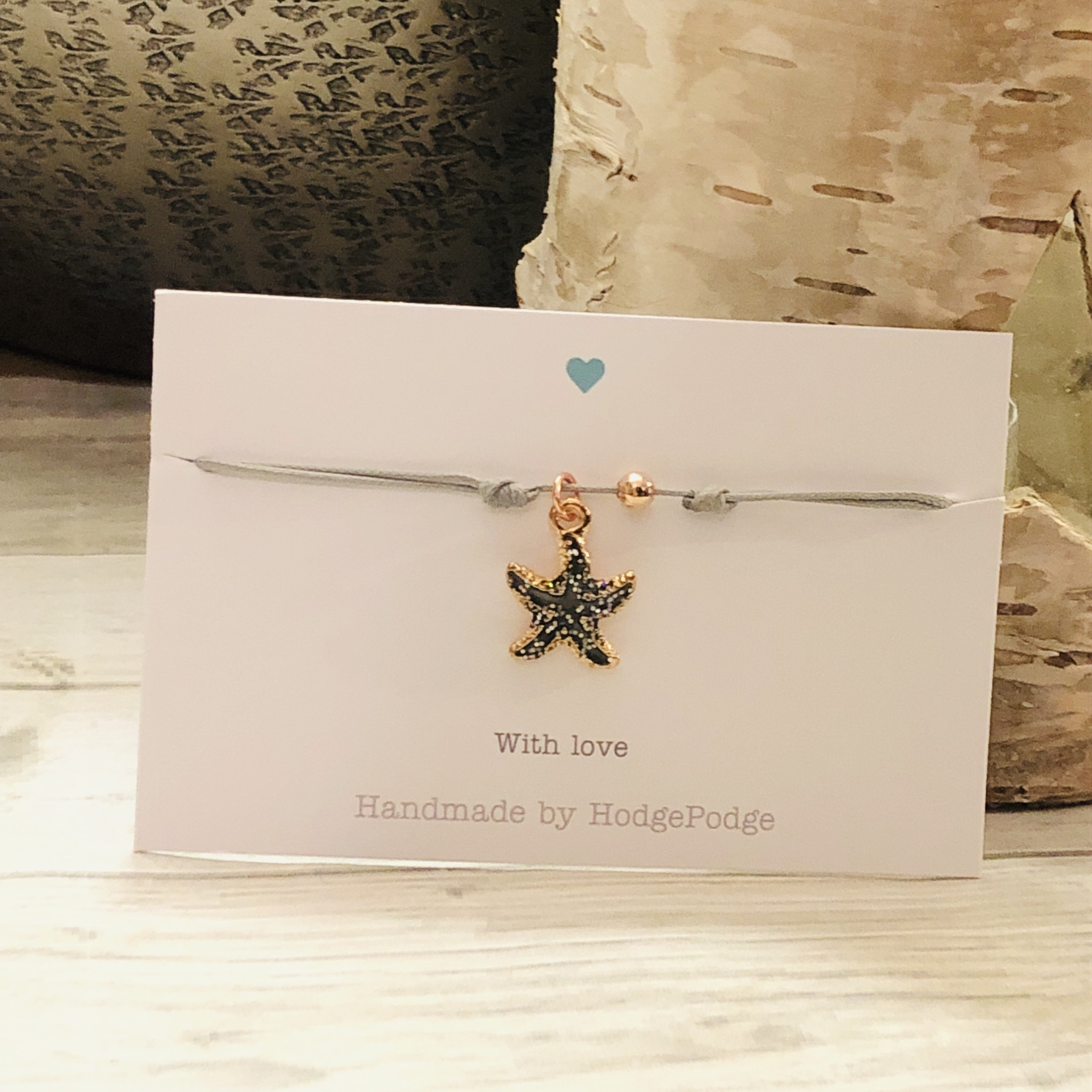 Starfish charm adjustable cord bracelet.