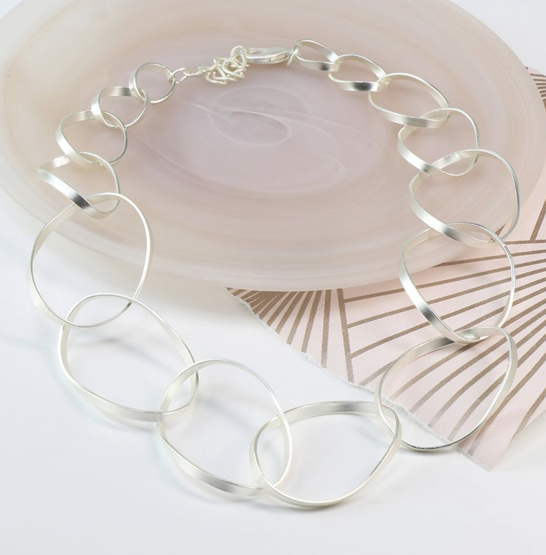 Silver plated matt finish twisted hoop necklace By POM peace of mind