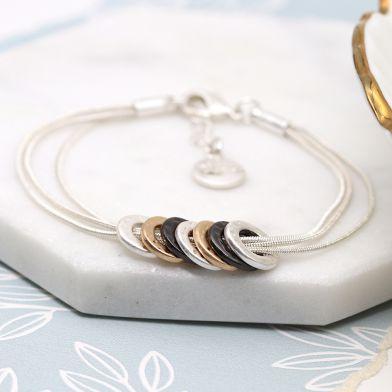 Mixed finish multi hoop triple strand bracelet by POM