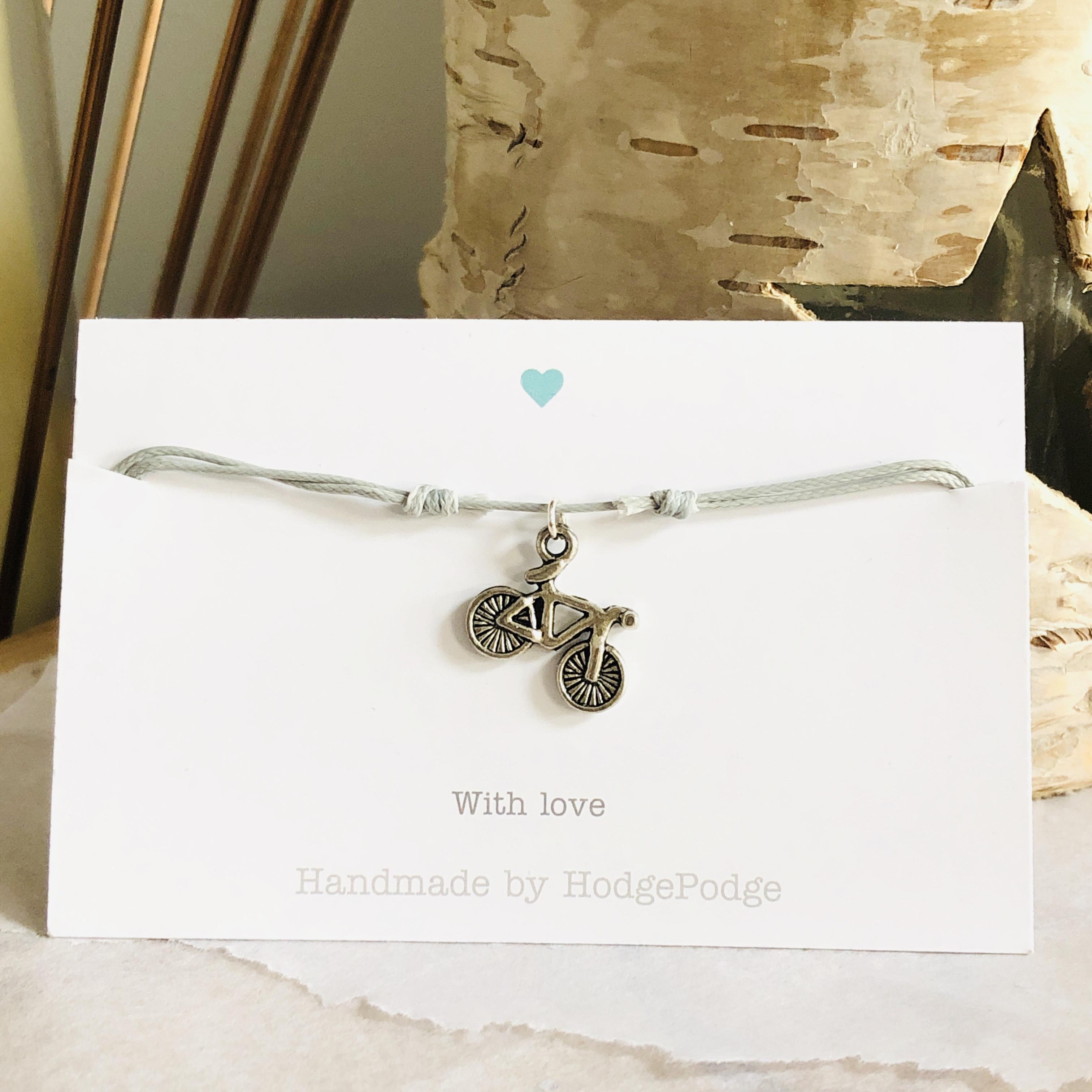 Adjustable cord bracelet with bike charm