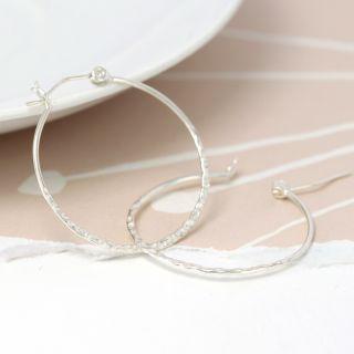 Hammered hoop sterling silver earrings