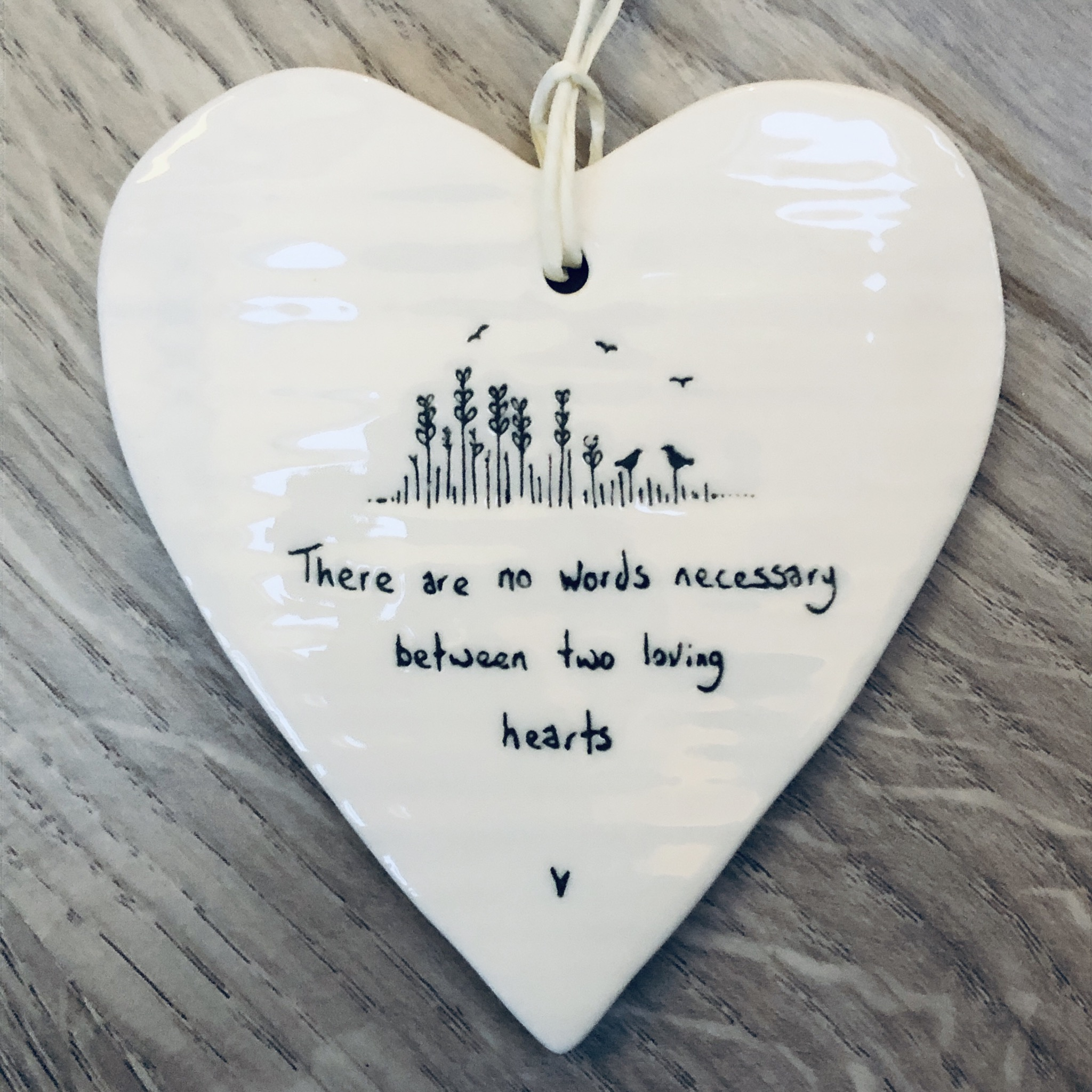 East of India porcelain hanging heart. There are no words necessary between two loving hearts