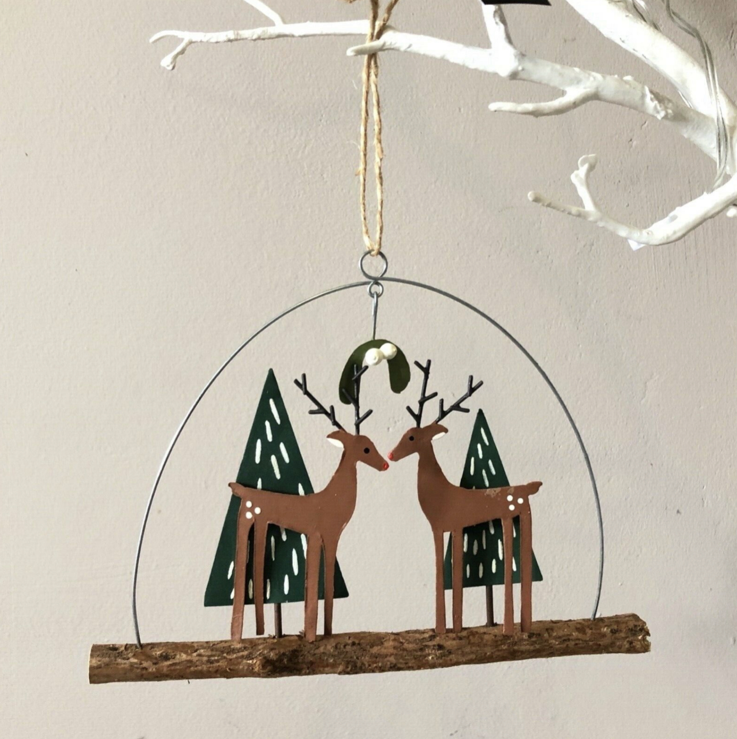 Chic deer couple under the mistletoe hanging decoration by shoeless joe