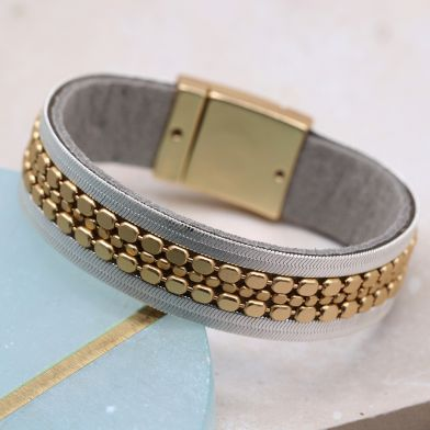 Golden dotted bracelet edged with silver flat chains by POM