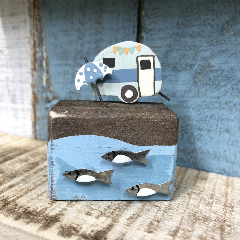 Retro caravan with parasol. Ornament by shoeless joe.