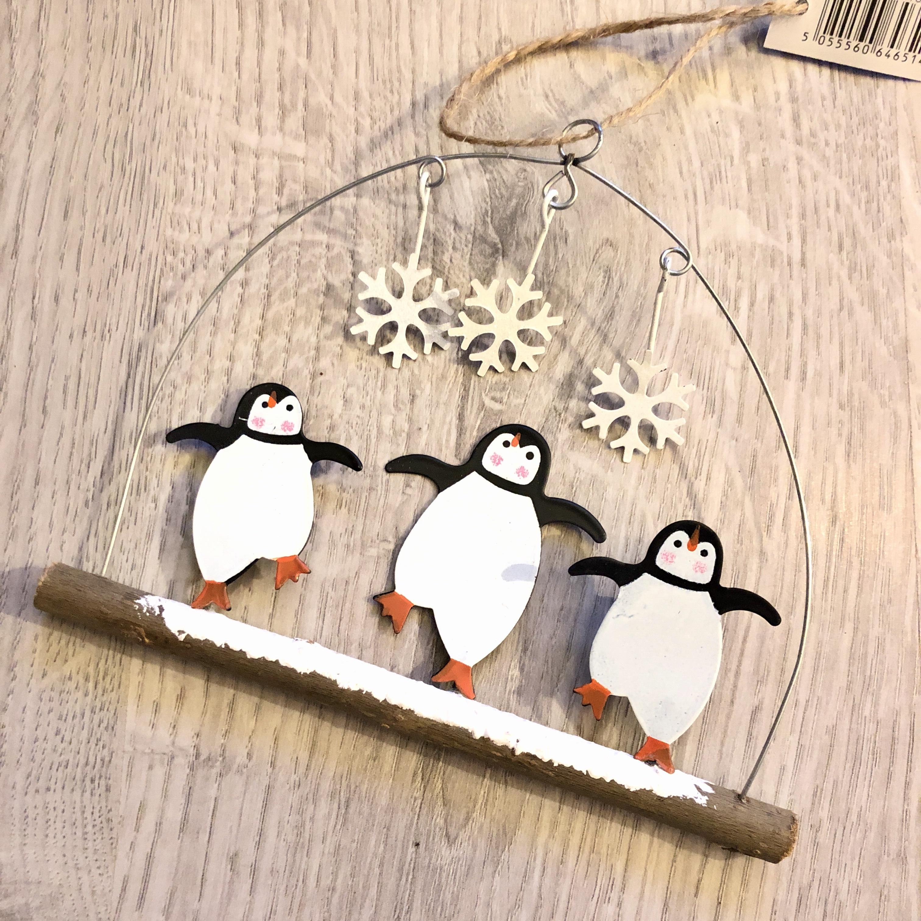 Dancing penguin dudes hanging Christmas decoration by shoeless joe
