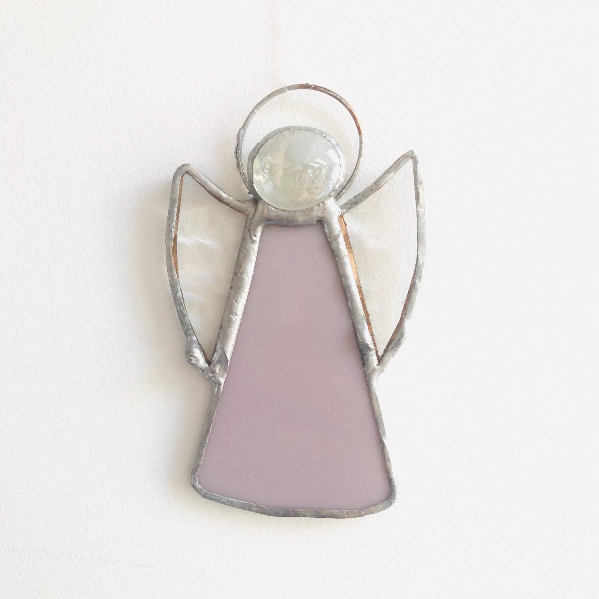Perc stained glass guardian angel in pink. Hand-made in Norfolk.